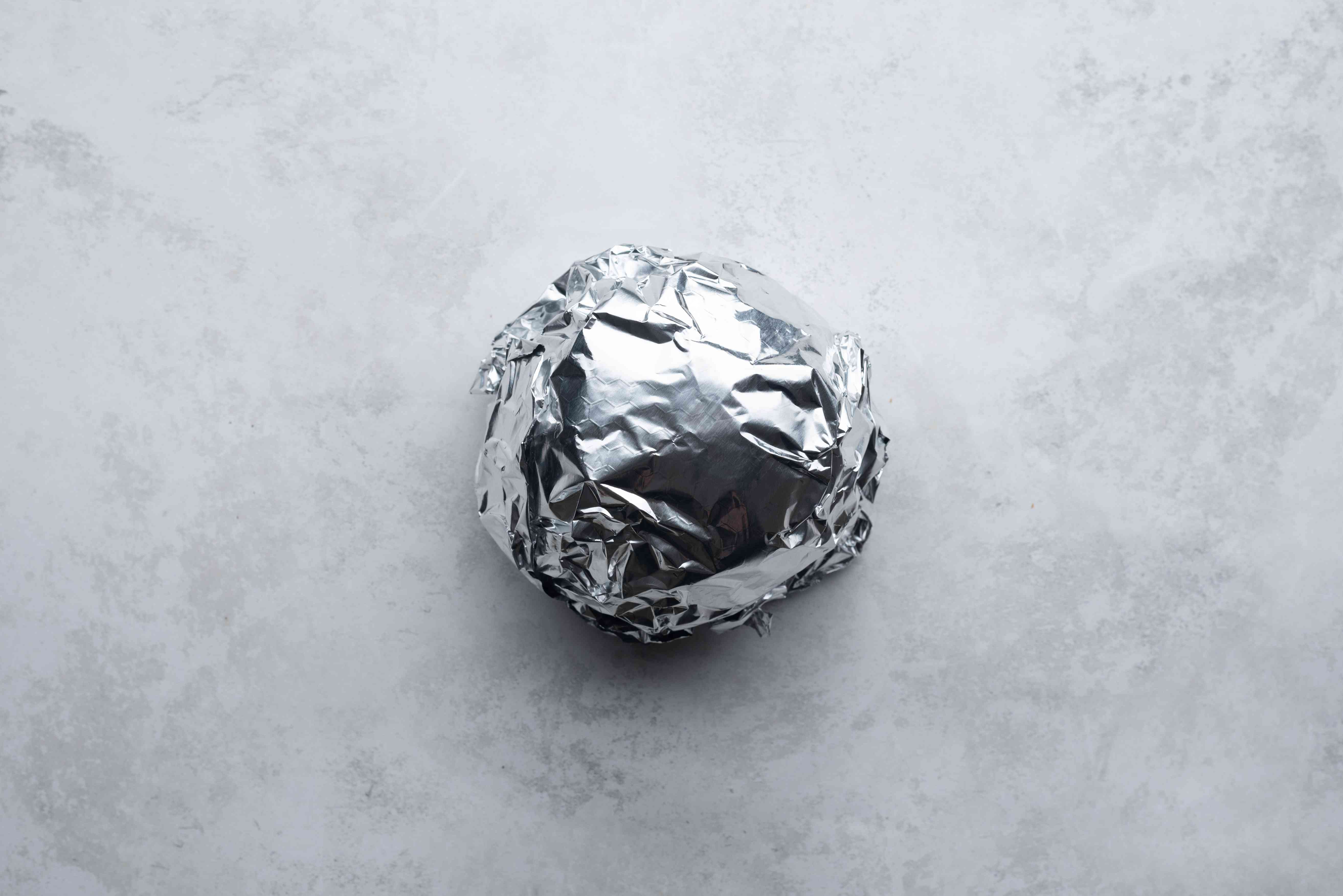 cheese ball wrapped with aluminum foil
