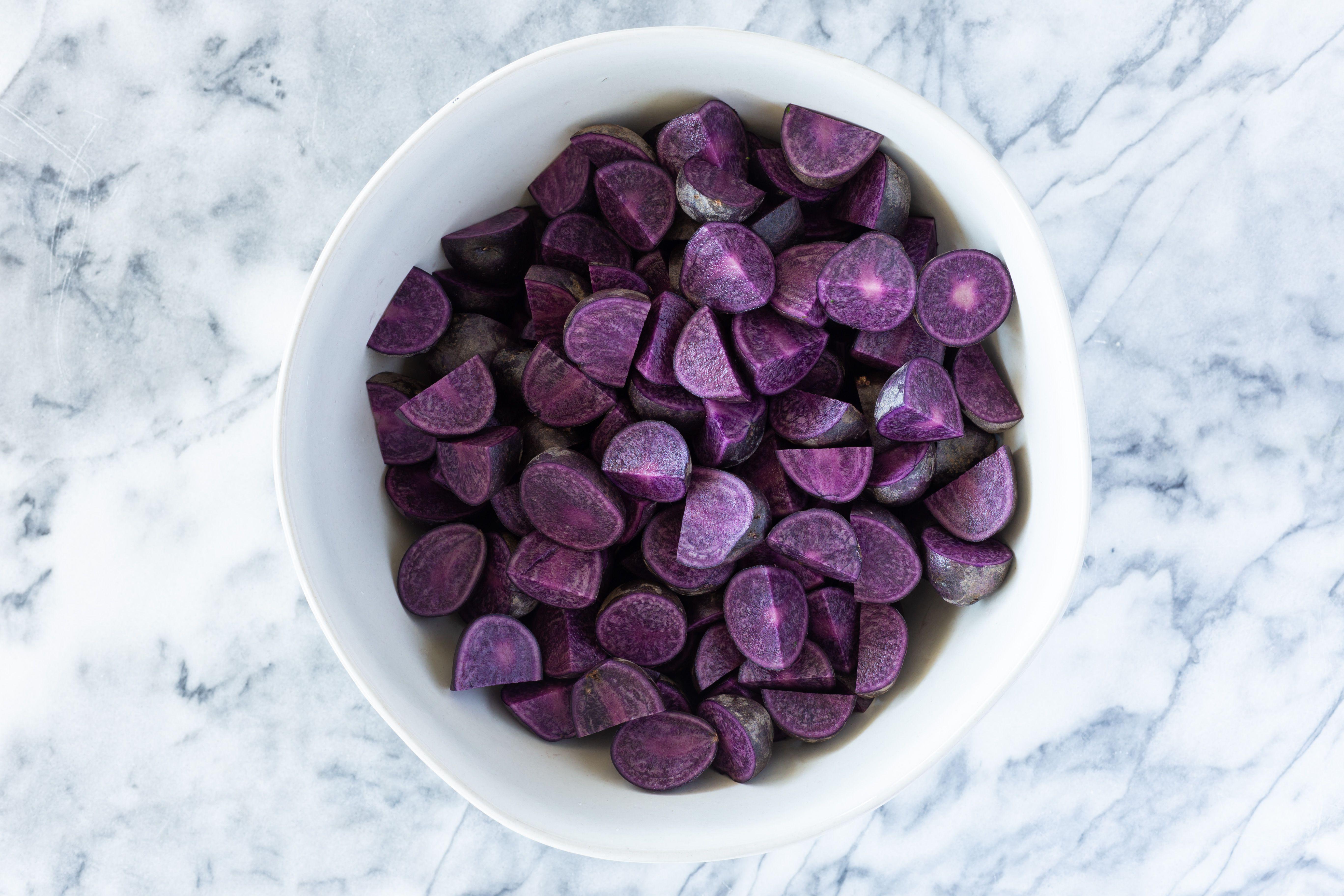 Purple potato quarters in bowl