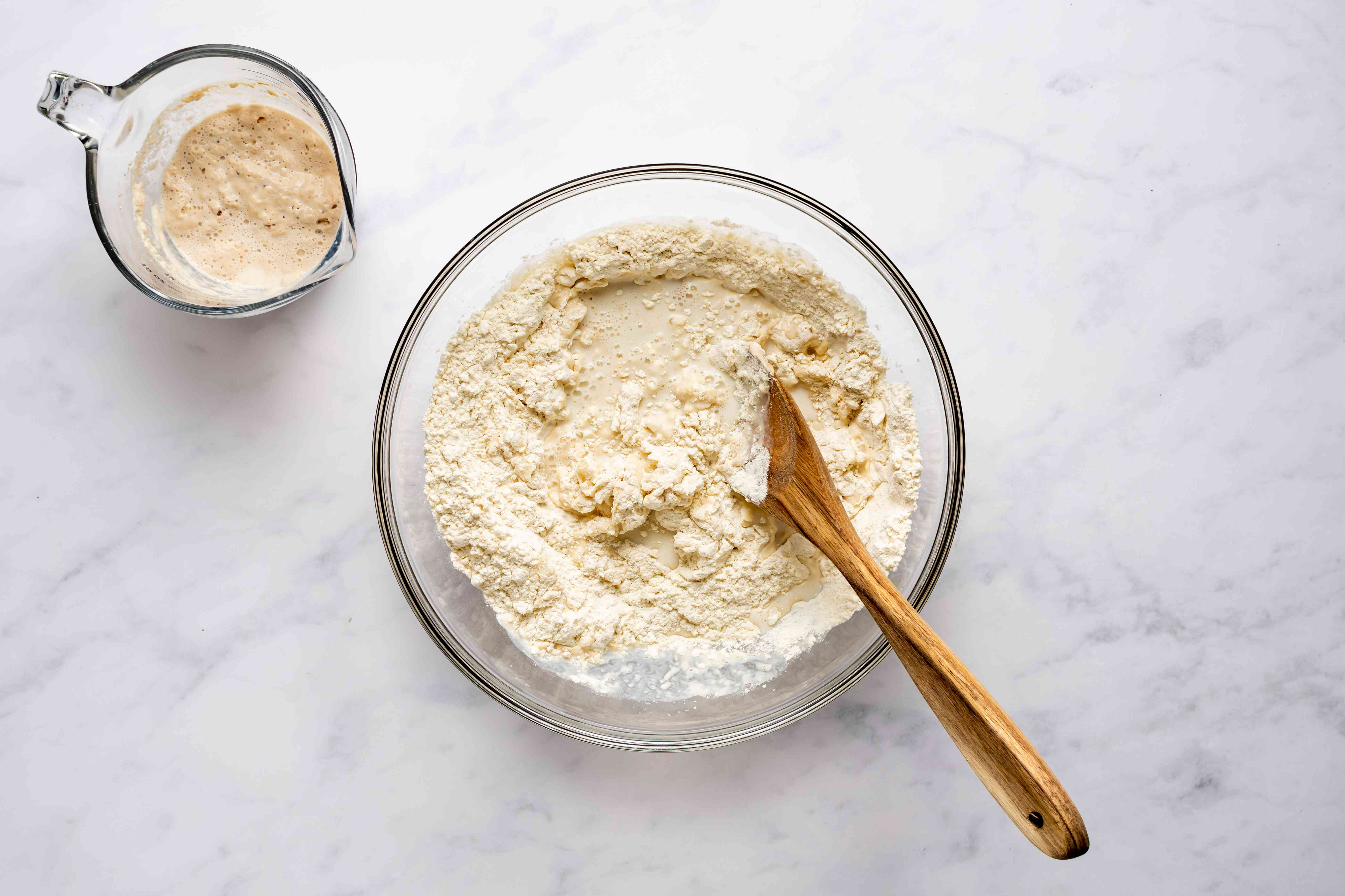 Gradually pour in the milk-yeast mixture into the flour