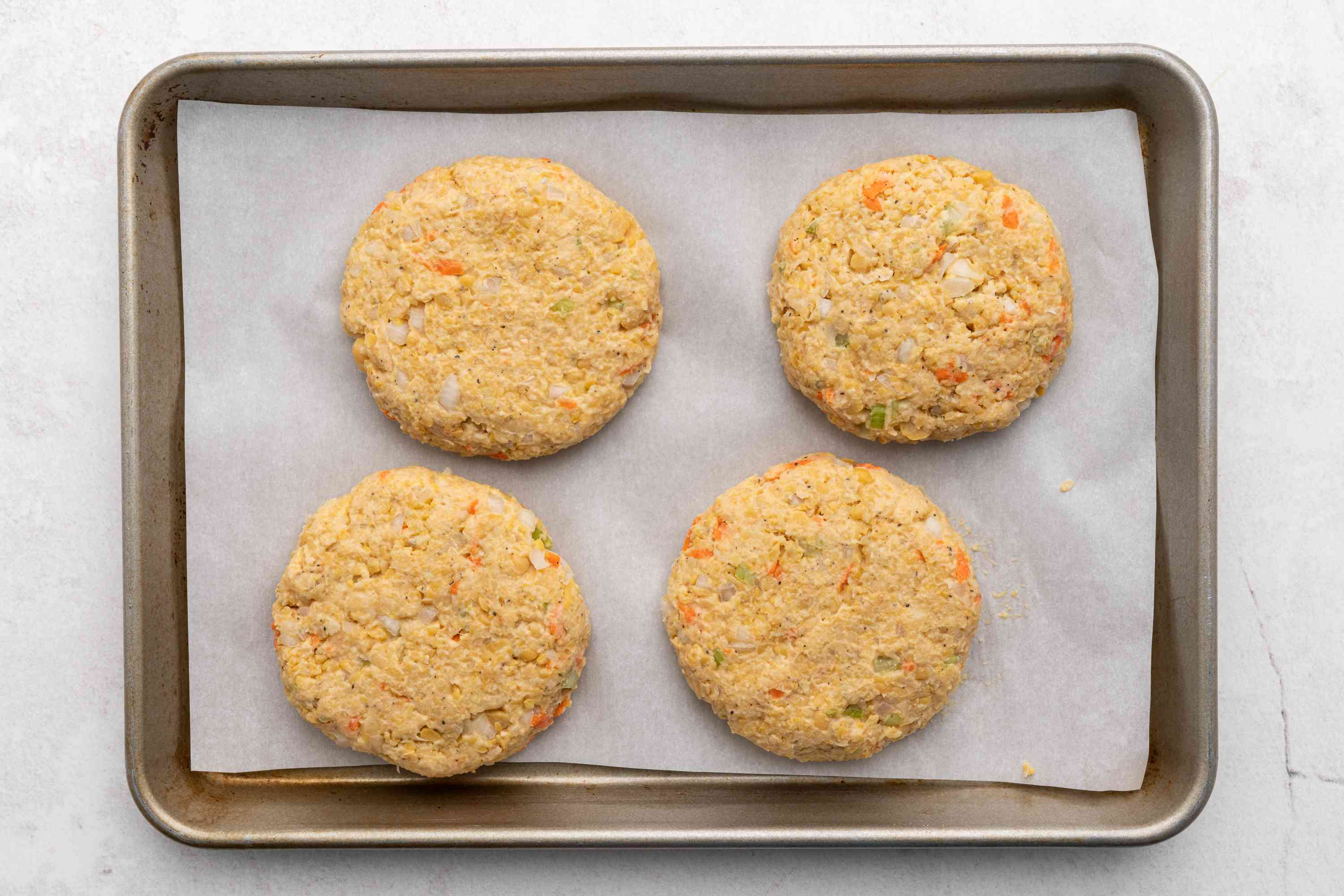 Formed patties on parchment-lined baking sheet