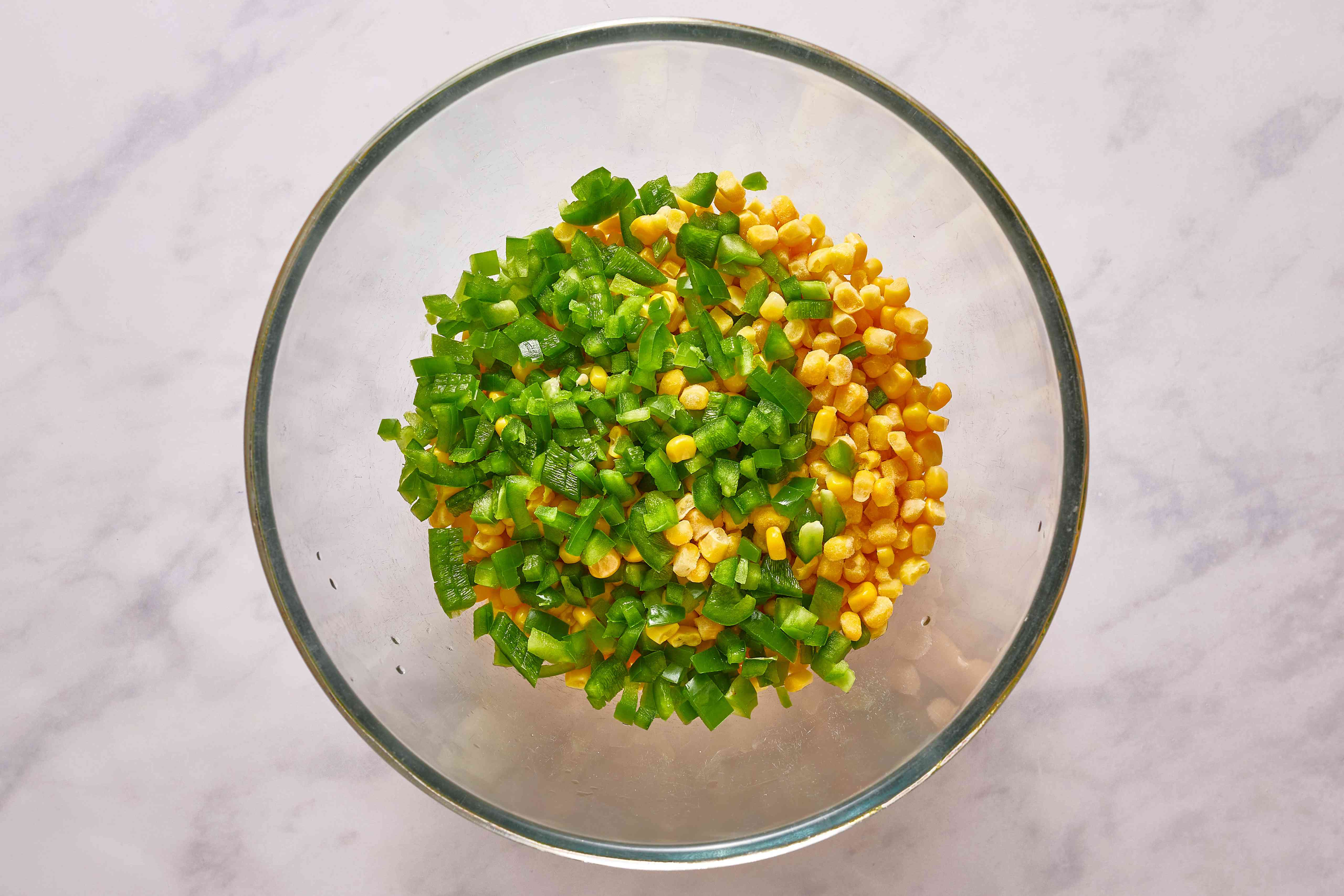 In a large bowl, place the corn kernels and the diced chile peppers
