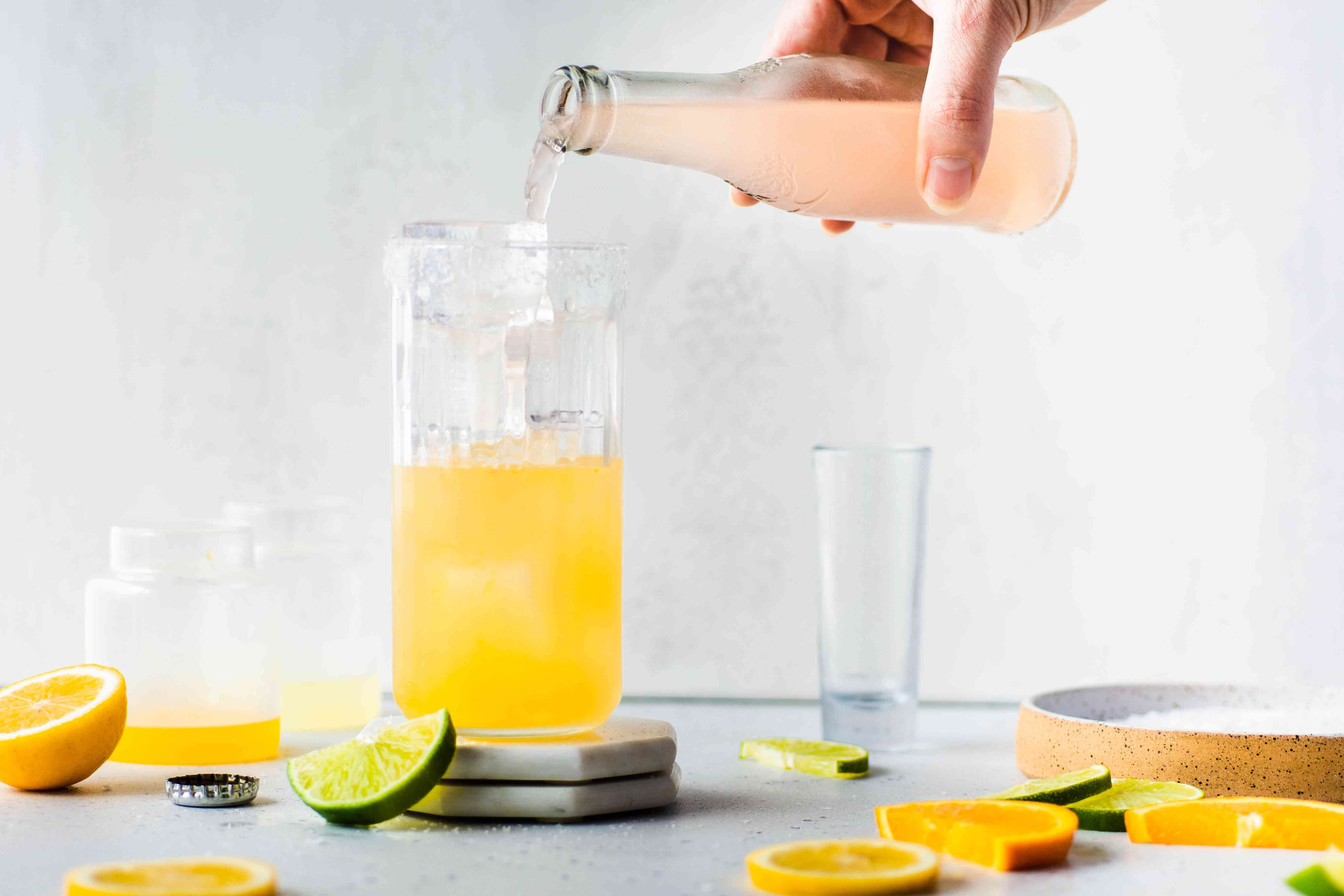Add grapefruit soda to the tequila and juice mixture