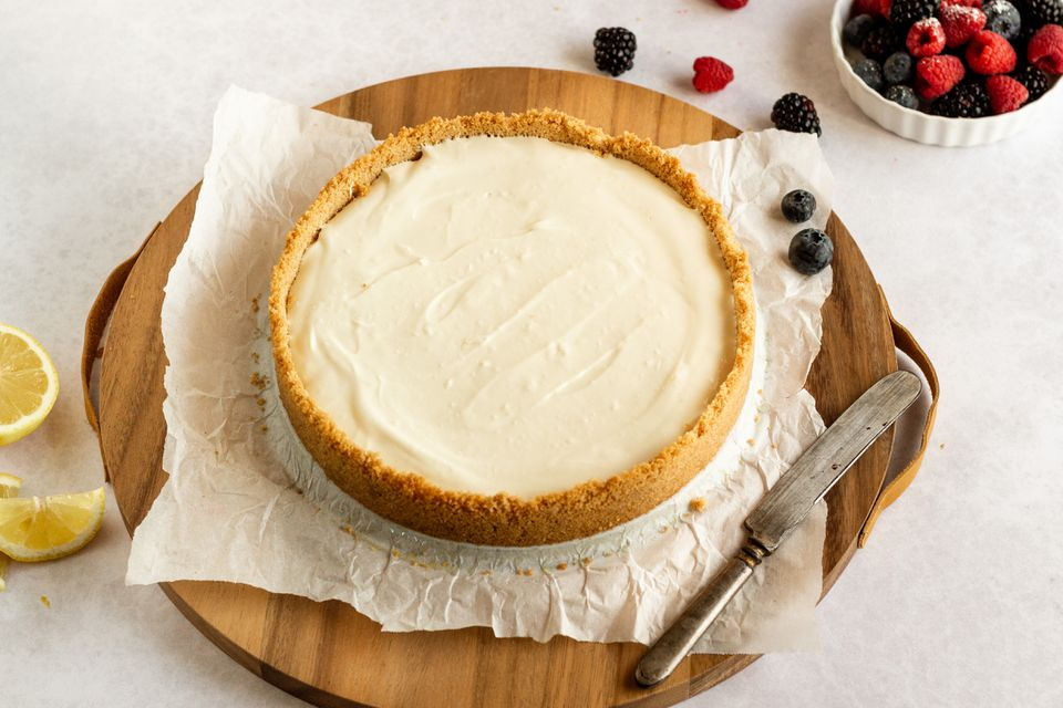 Fastest cheesecake recipe on a wooden board with berries