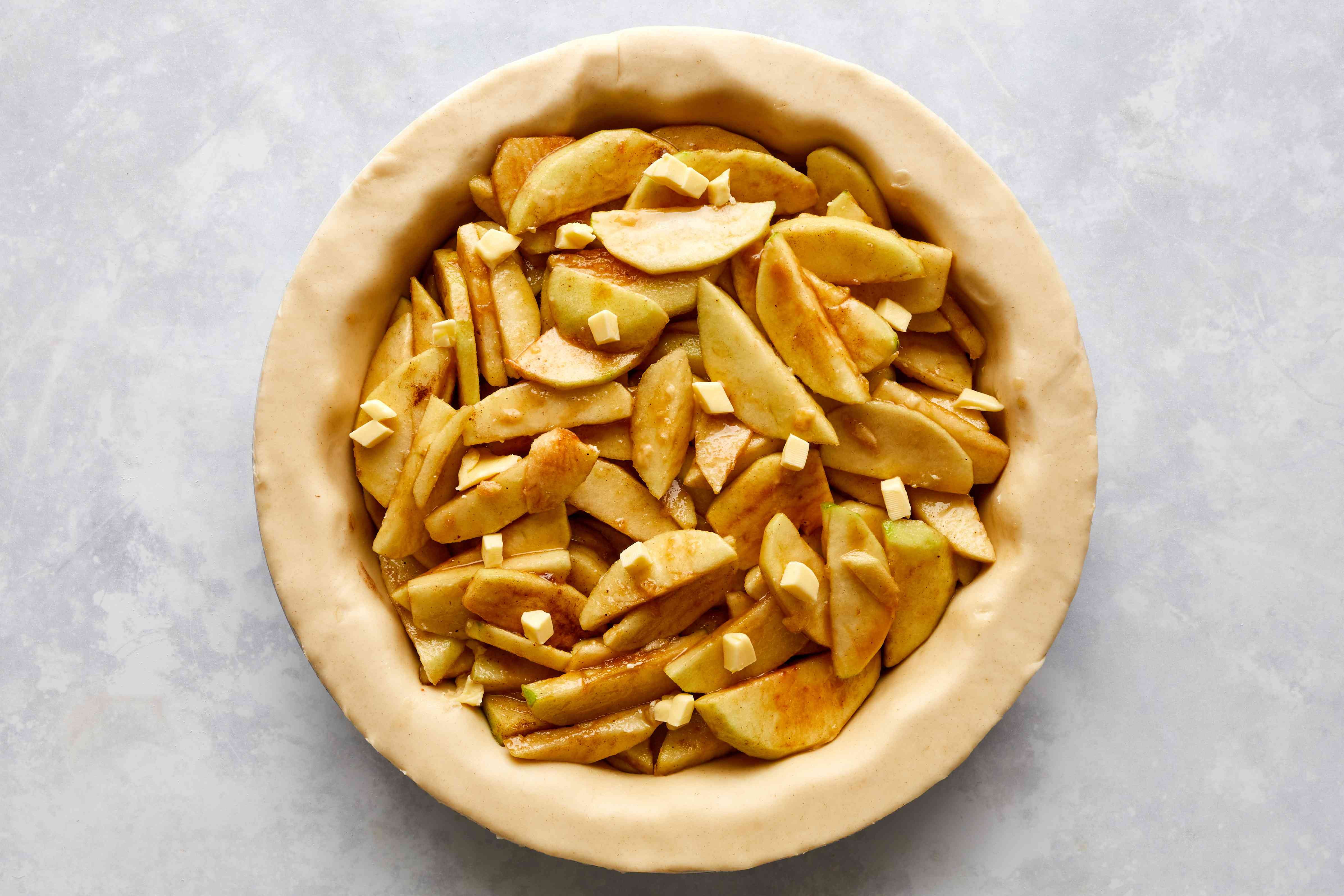 Apple slices mounded on the pie crust