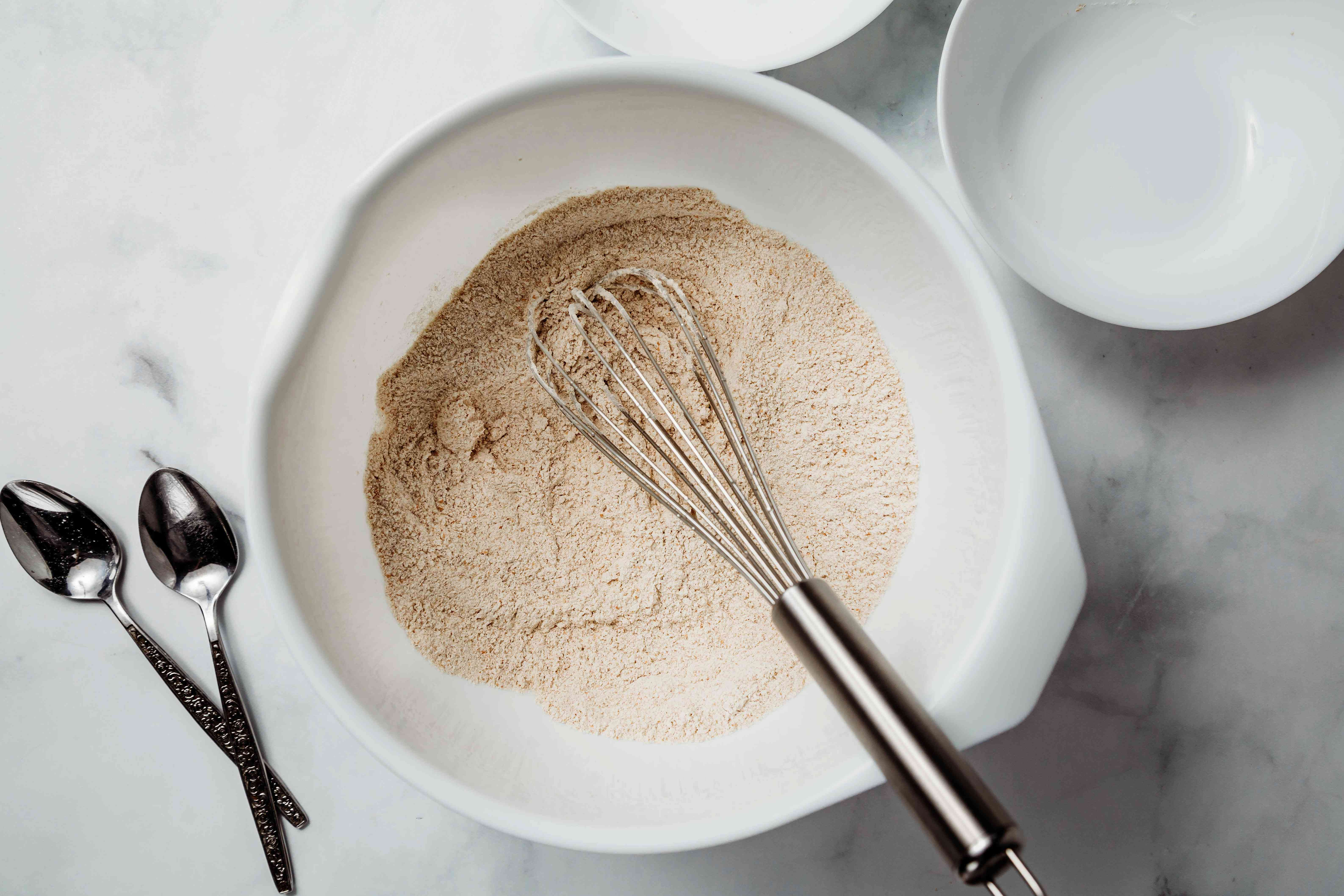 whisk together the whole wheat and spelt flours, salt, and baking soda