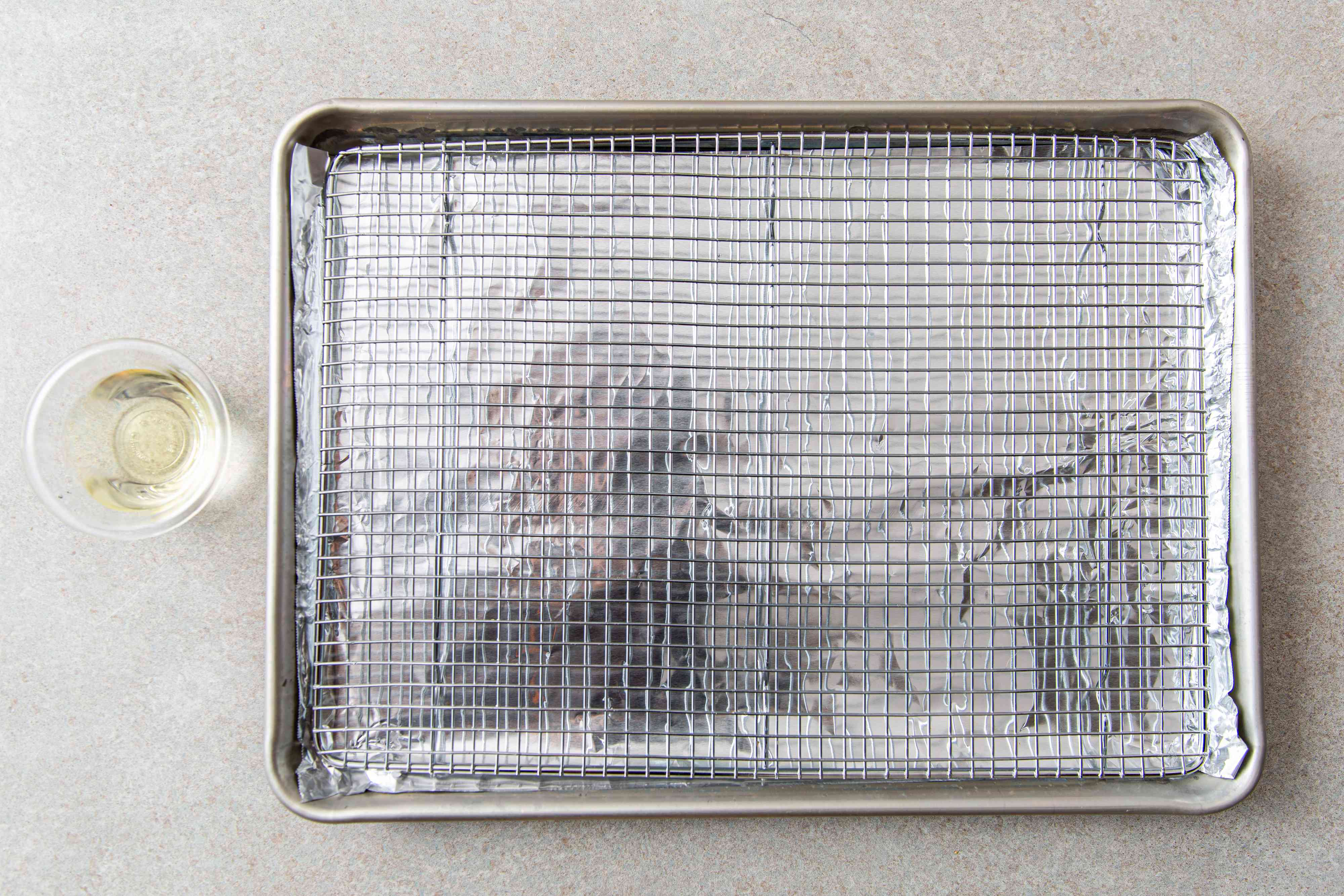 Metal wire rack and aluminum foil on top of a sheet pan