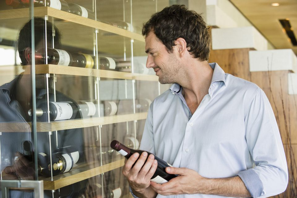 man using wine rack