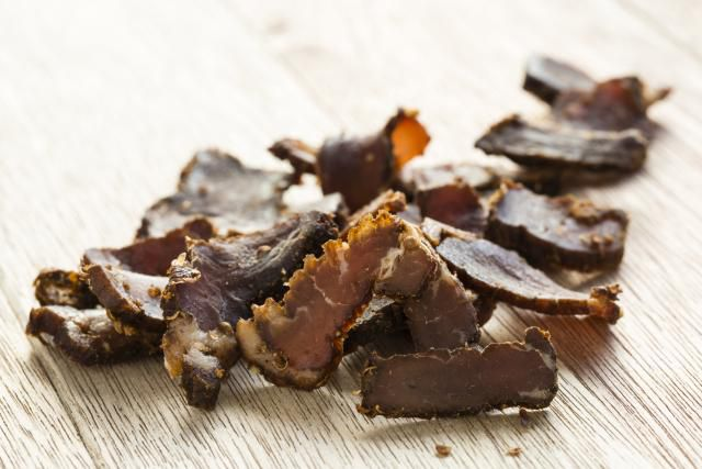 beef jerky pieces on wood
