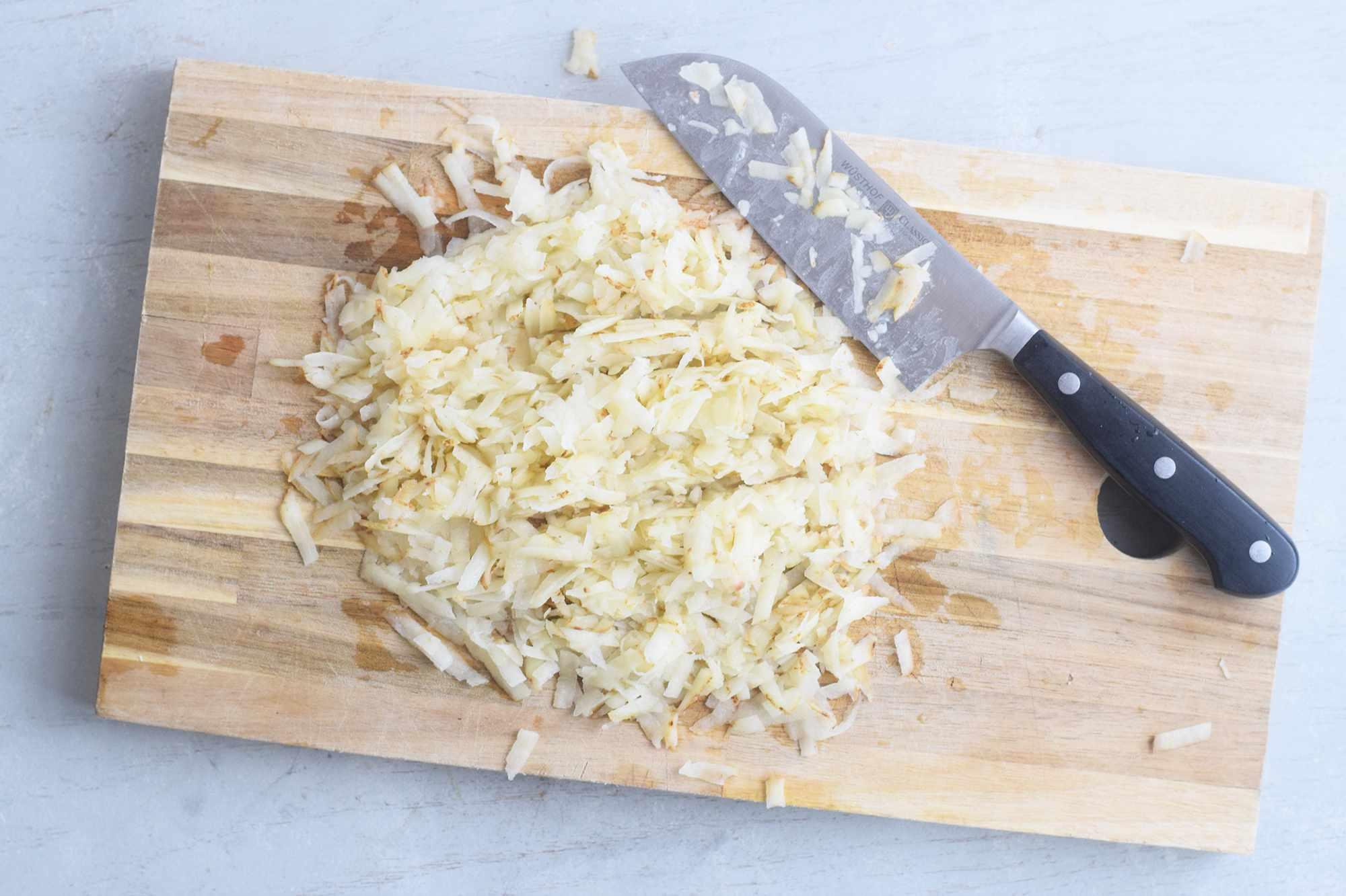 Chopping the potato shreds into smaller pieces