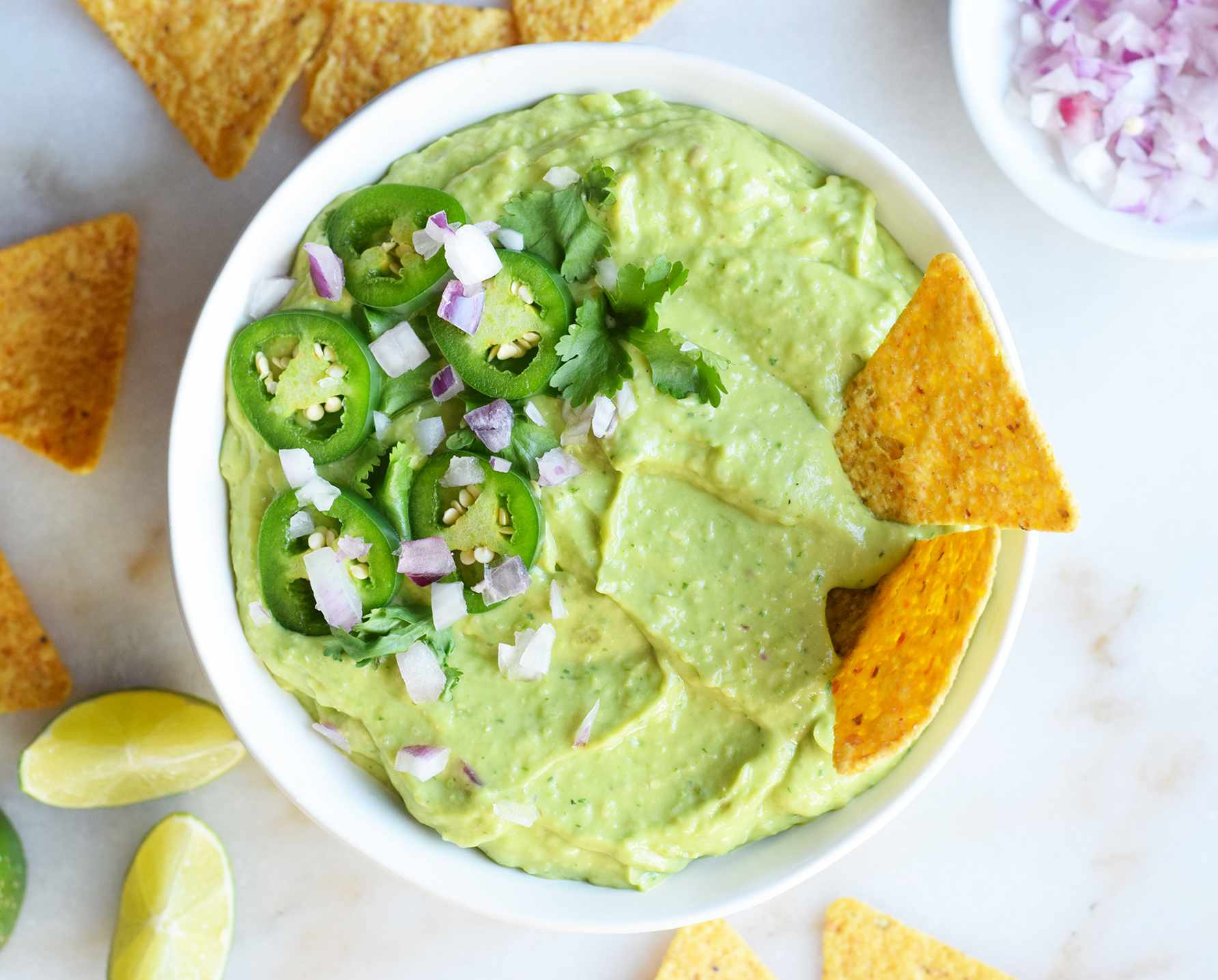 guacamole salsa in a bowl with chips