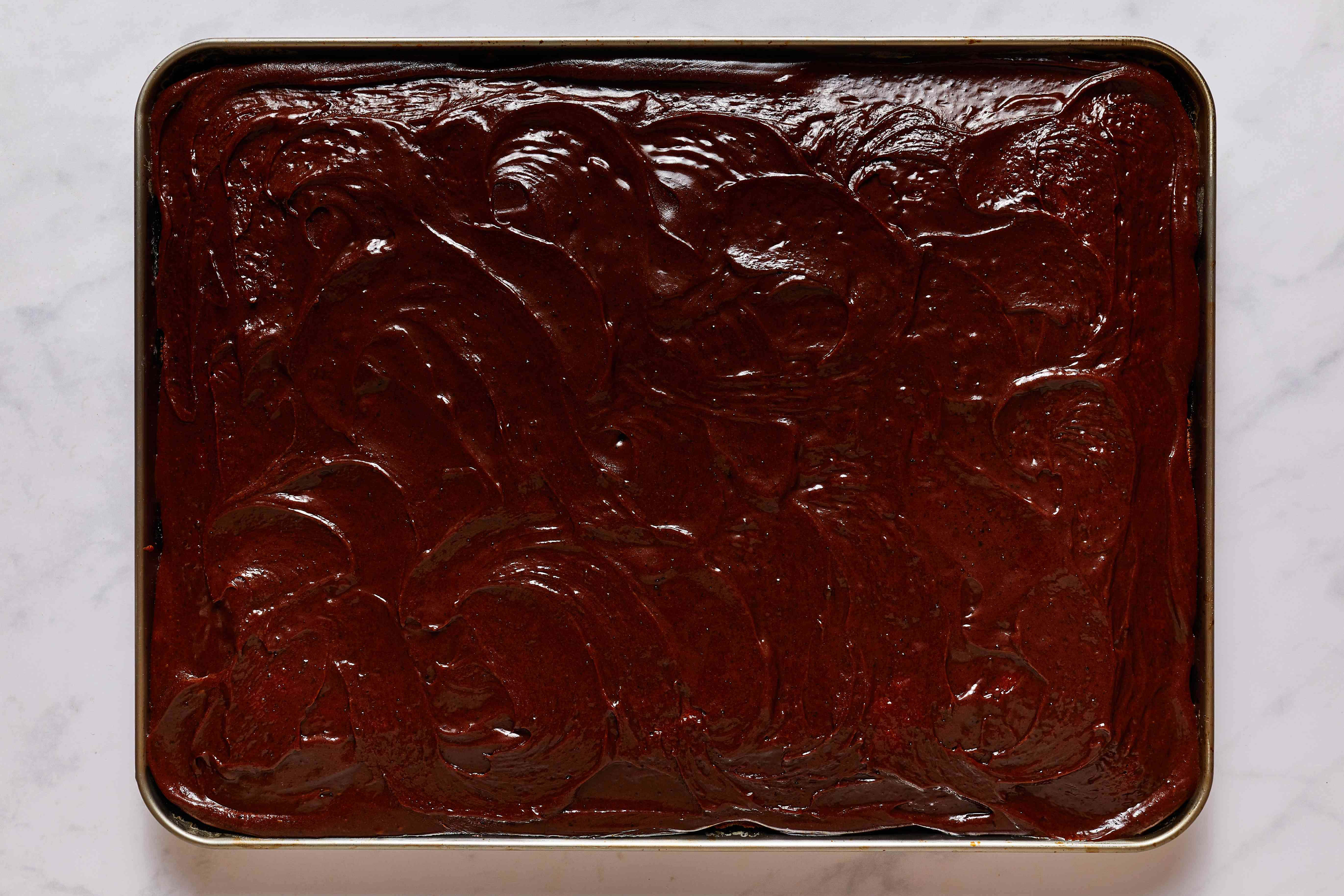 frosting on top of the baked brownies
