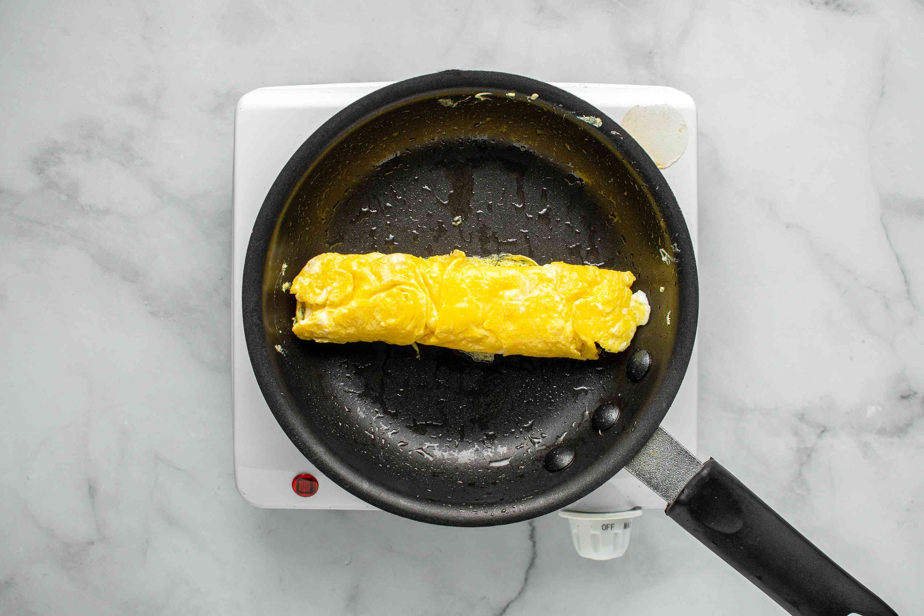 omelet roll in a pan