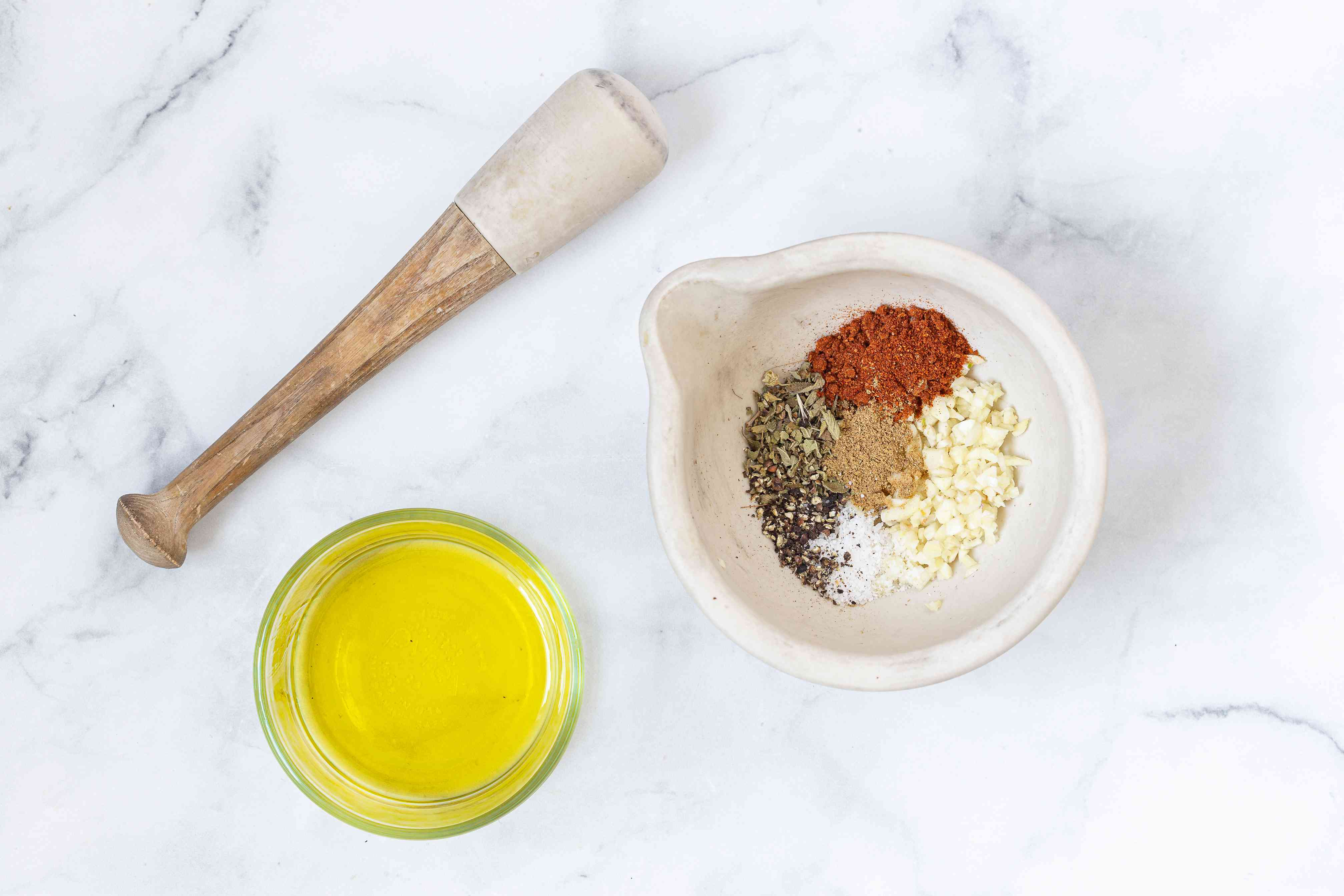 Combine garlic spices in a mortar and pestle