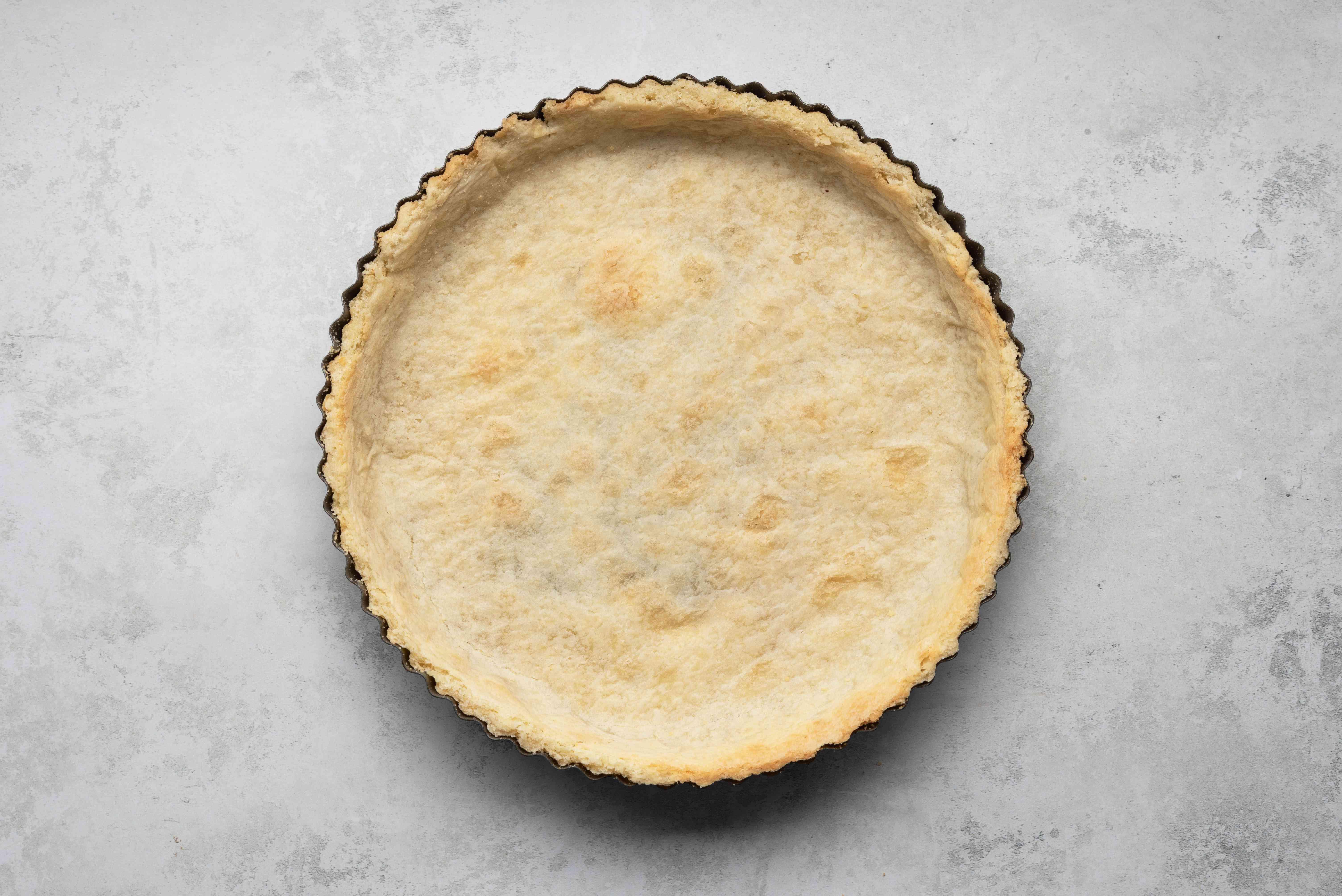 baked tart crust in a tart pan