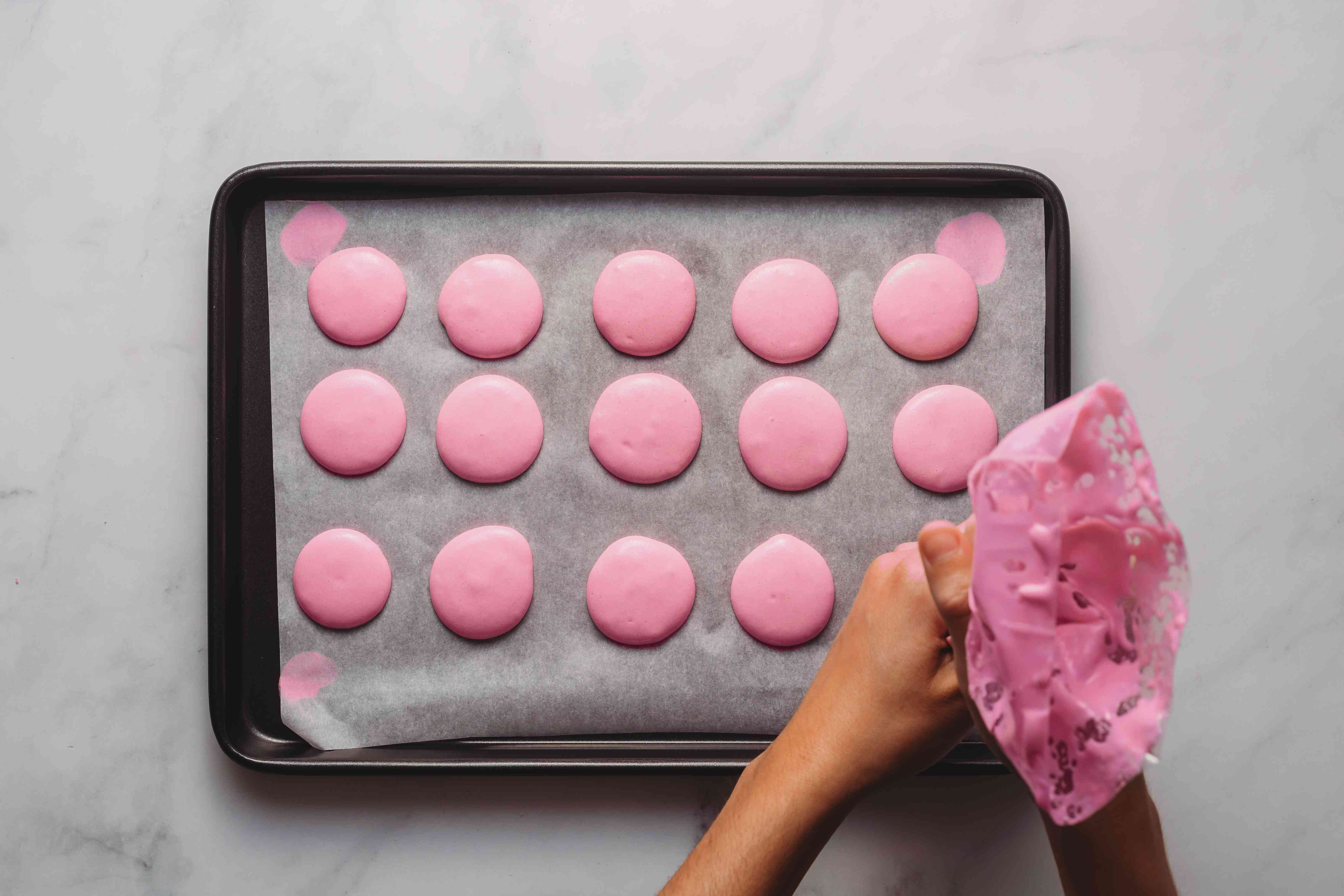 meringue piped on a baking sheet