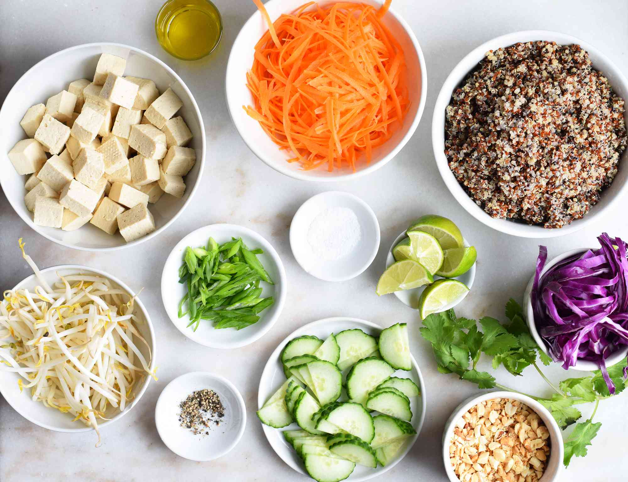 ingredients for buddha bowls on a marble board