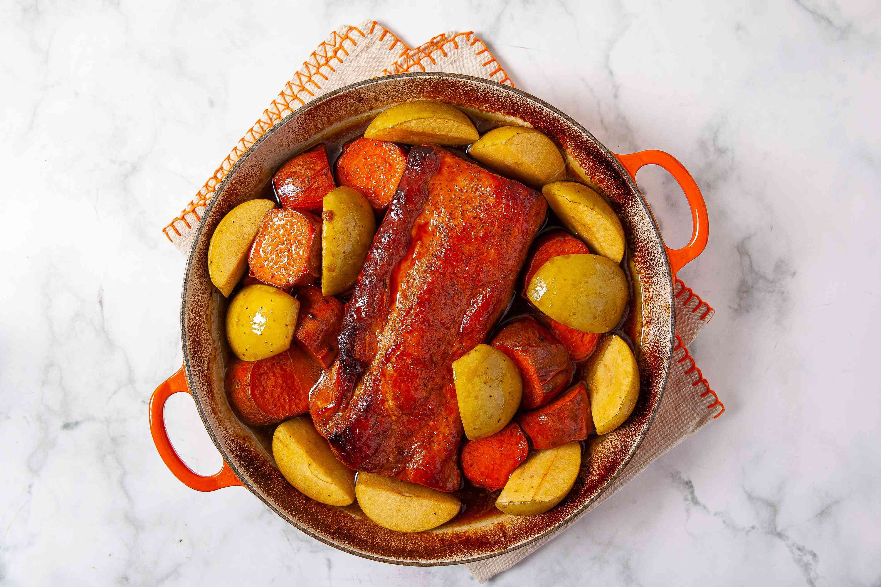 Roast Pork Loin With Sweet Potatoes and Apples in a dutch oven