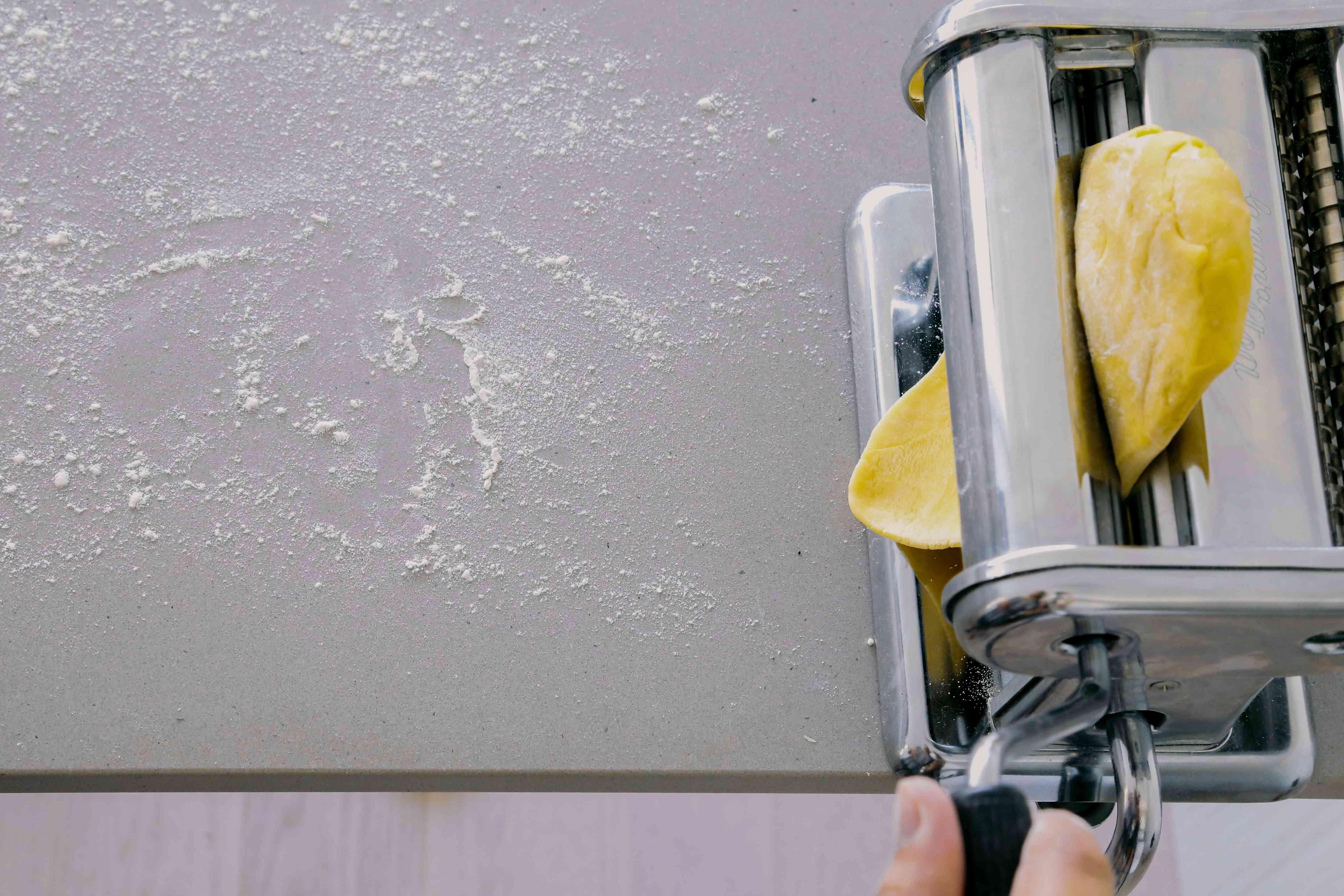 pasta dough in a pasta roller