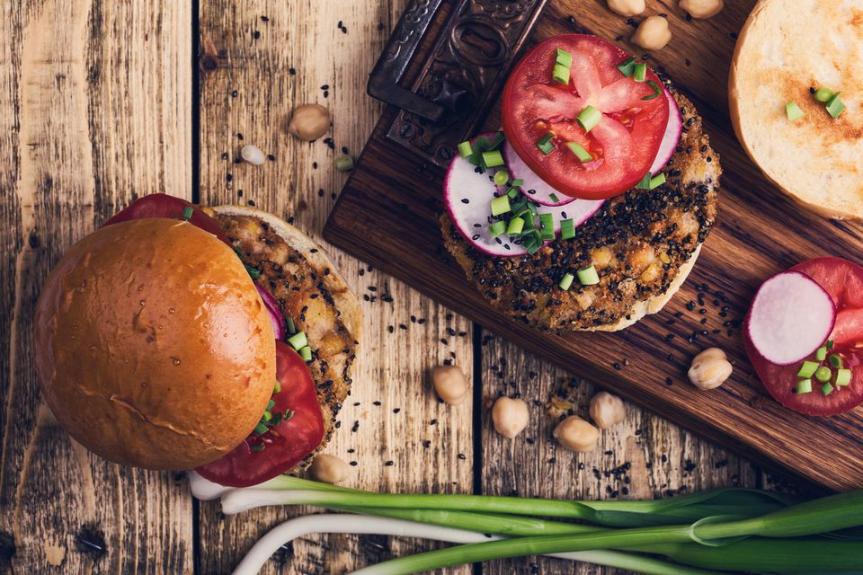 Chickpea veggie burger with fresh vegetables, top view