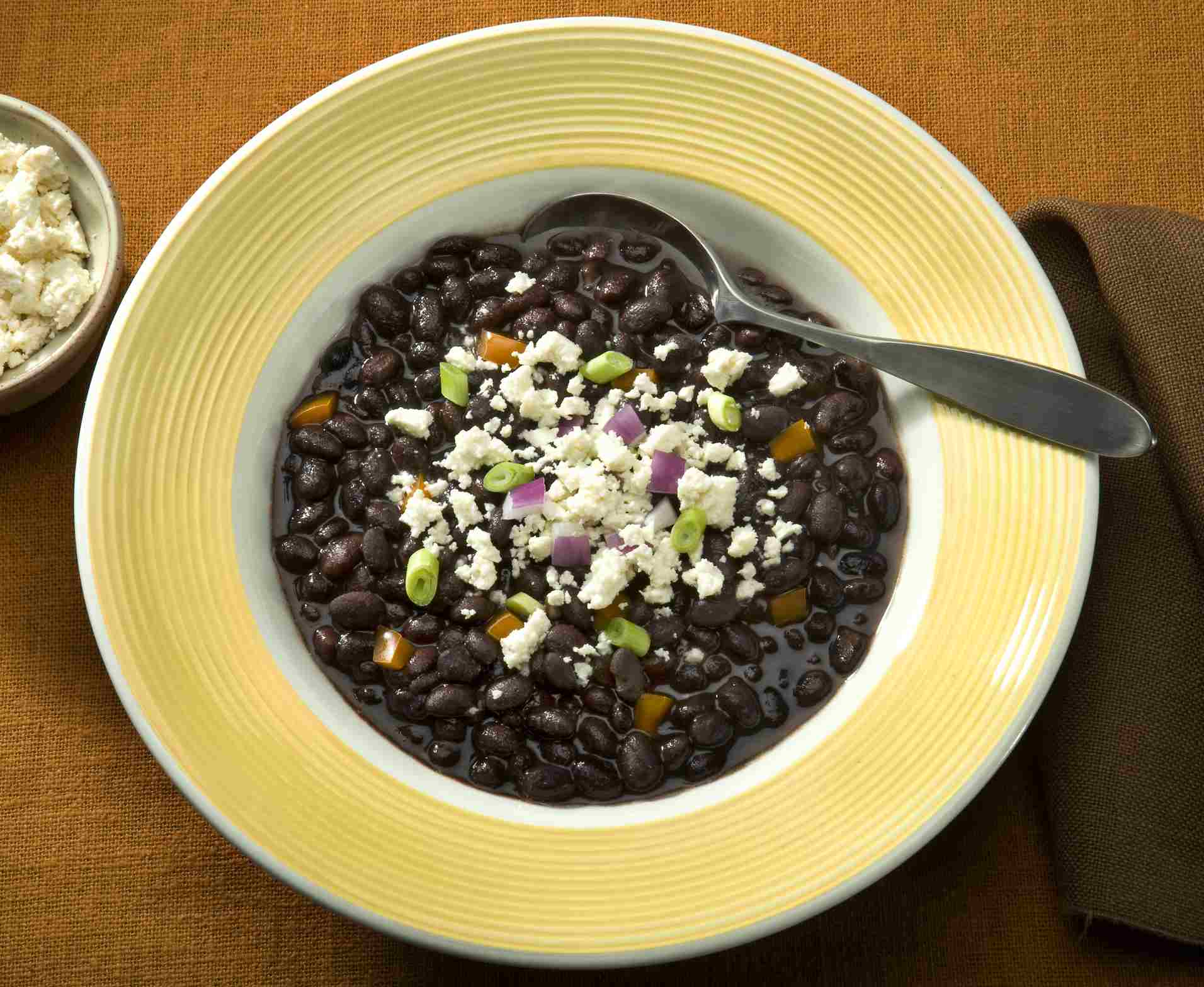 Black Bean soup sprinkled with Queso crumbled cheese