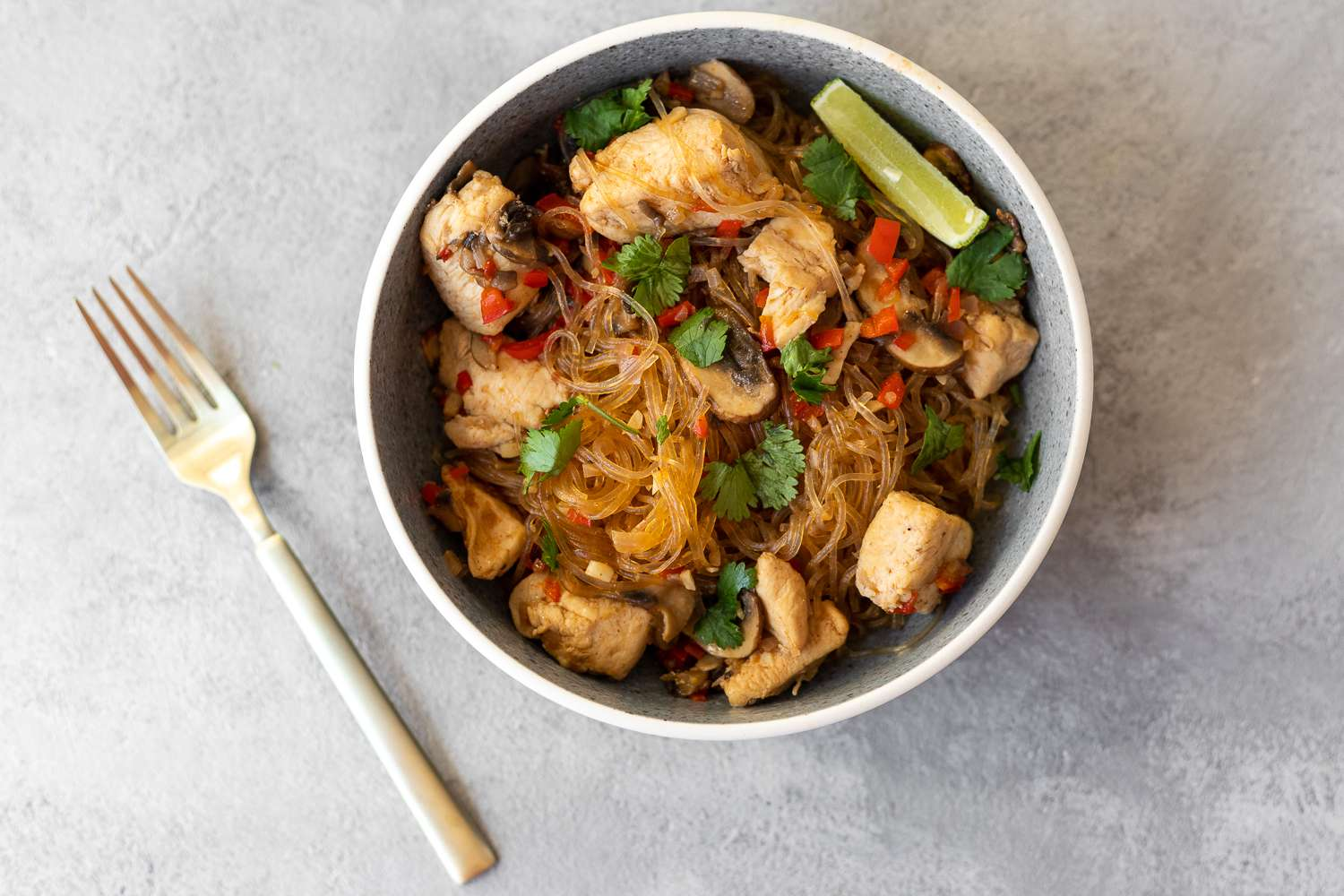 Thai Glass Noodle Stir-Fry With Chicken and Vegetables in a bowl