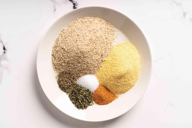combine breadcrumbs, cornmeal, Creole seasoning, salt, parsley, and thyme