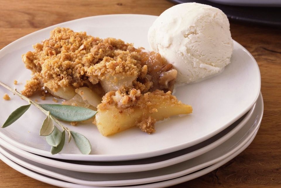 british apple crumble with ice cream on a plate