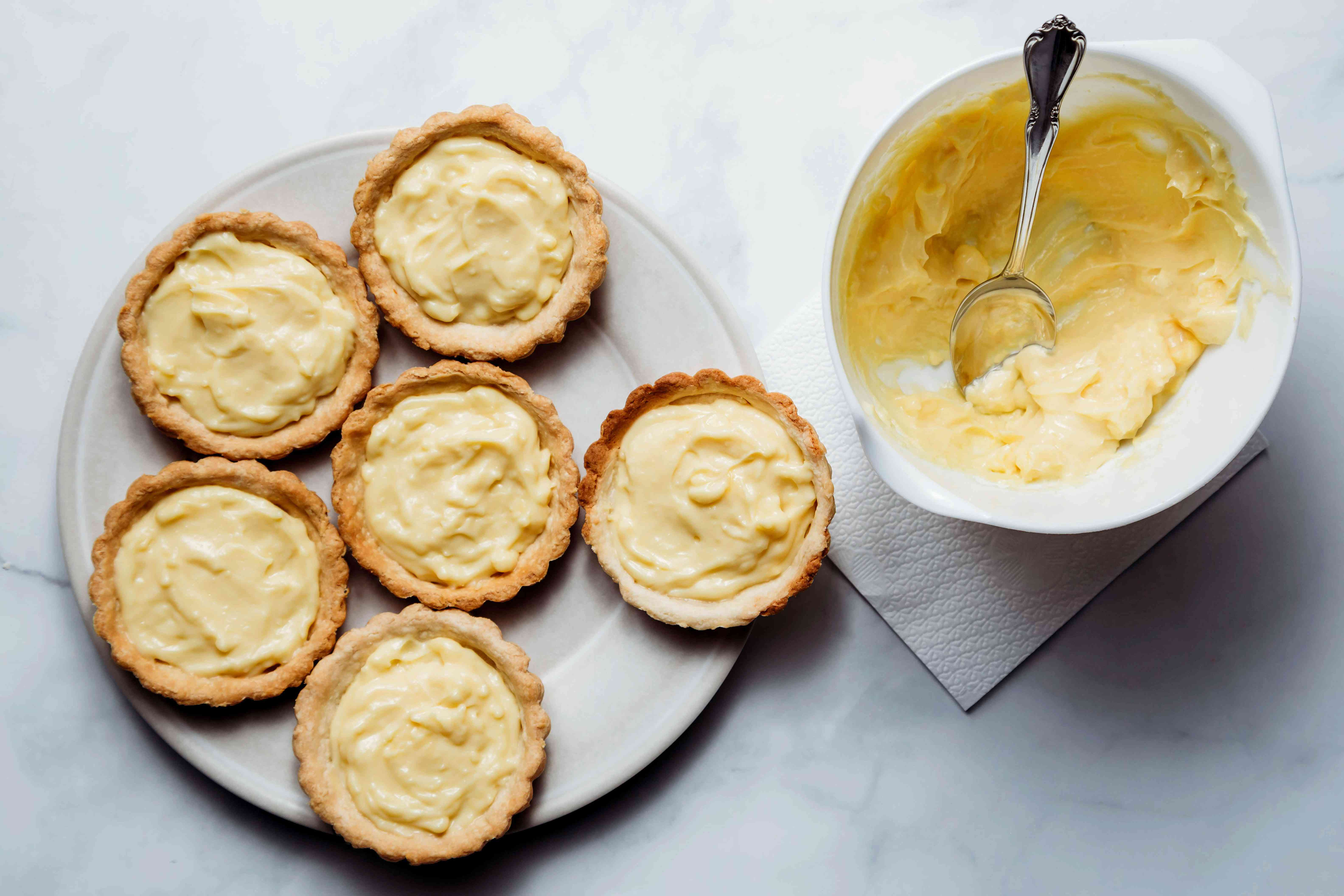 tart shells with pastry cream inside