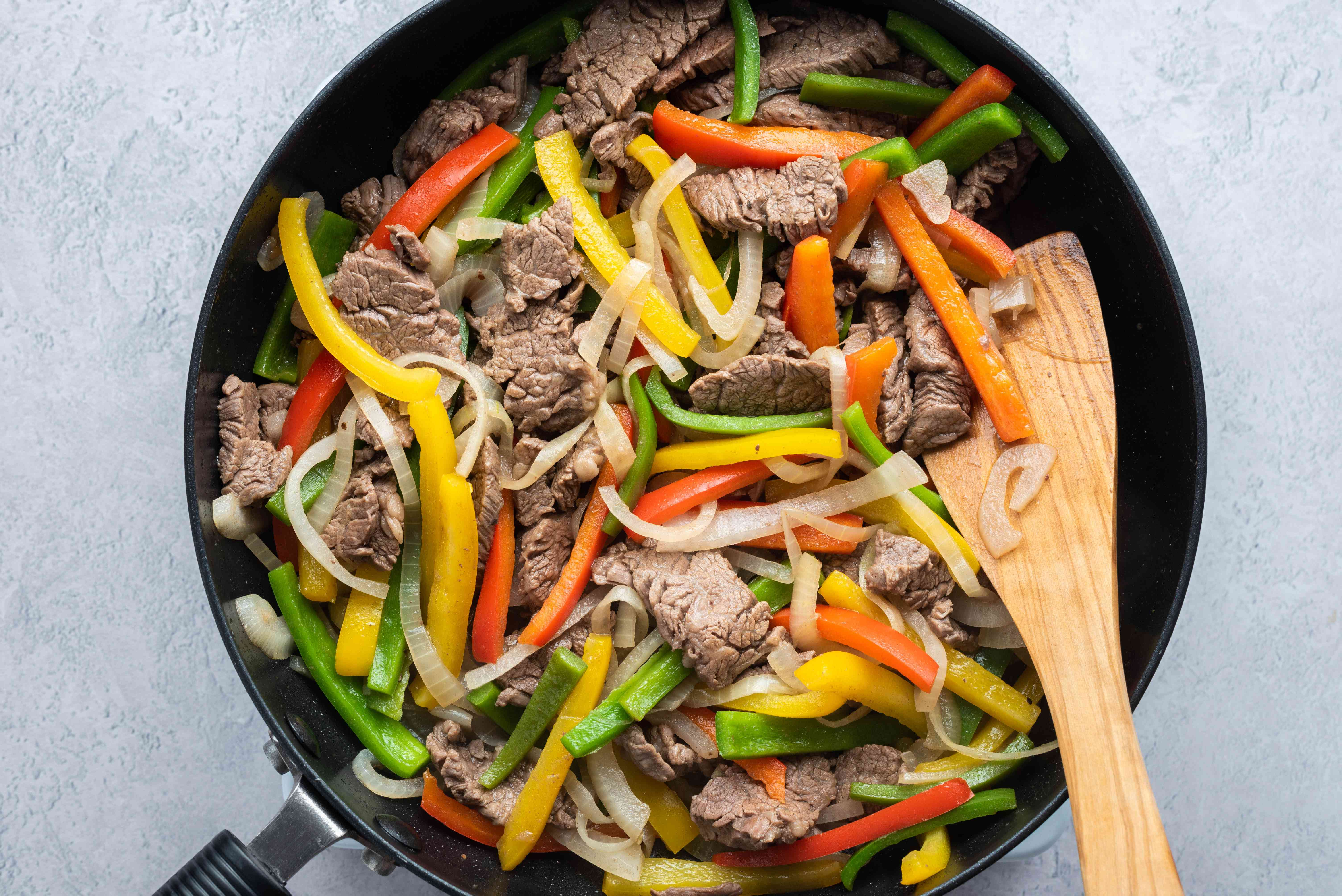 Cooked meat and vegetables in a pan