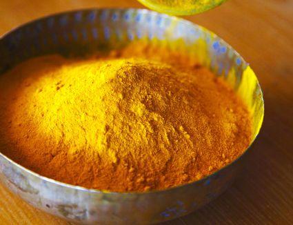Tumeric spice measured into a bowl