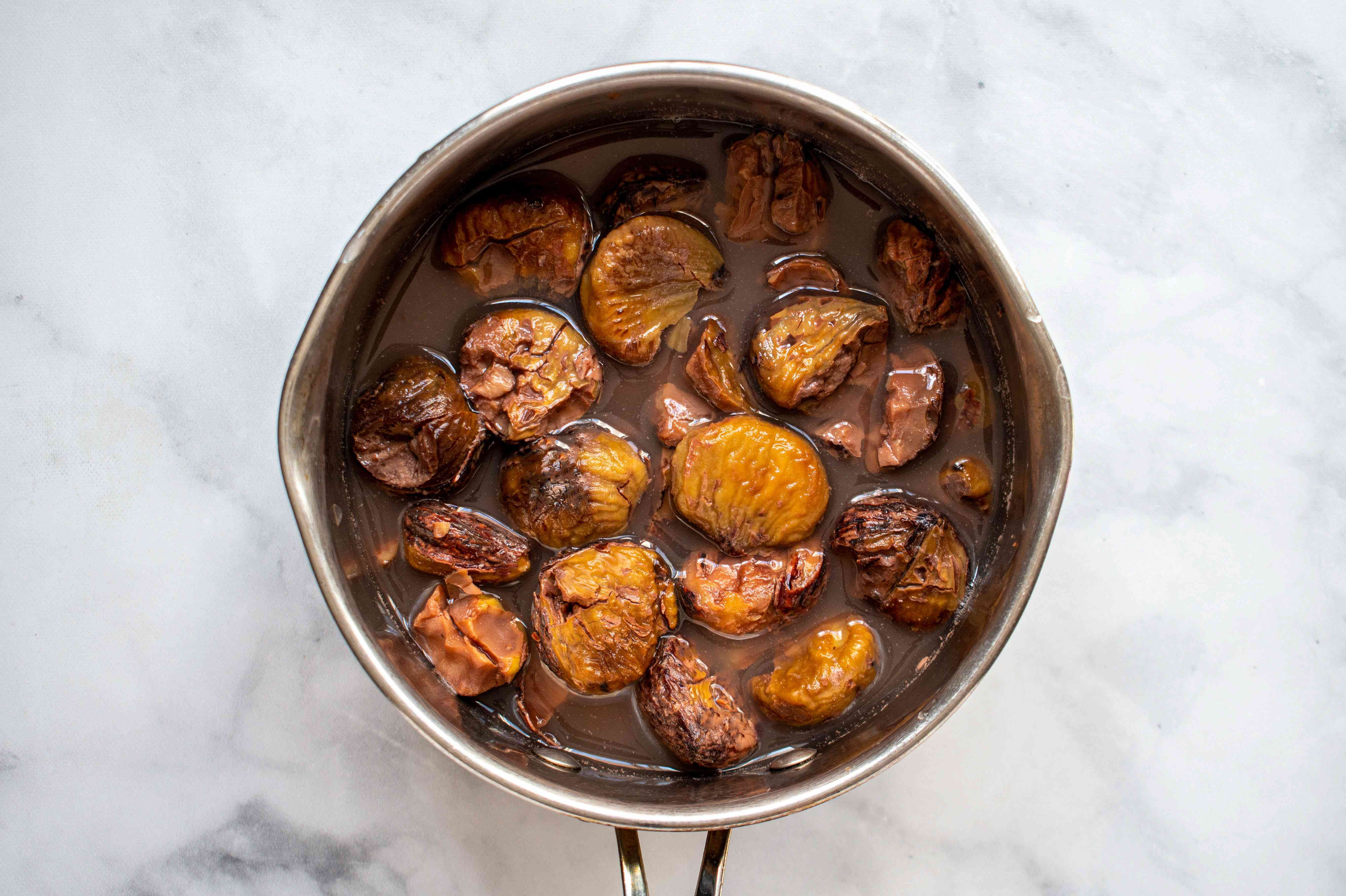 chestnuts in a saucepan brought to a boil