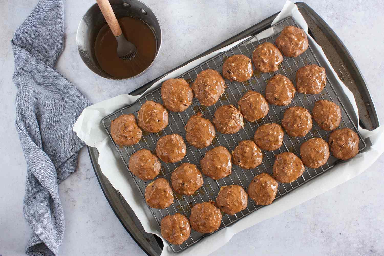 Brush glaze on cookies