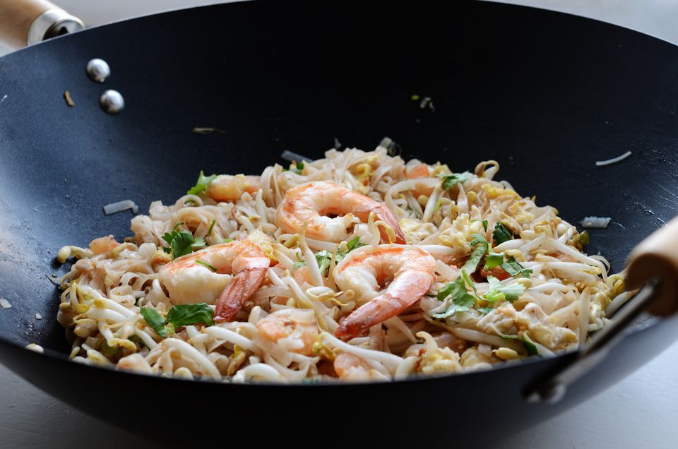 Phad Thai - stir-fried rice noodles with prawns in a wok