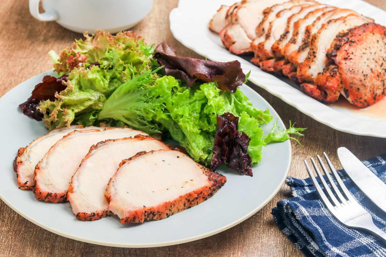 Simple seasoned pork roast with garlic and a meslcun mix