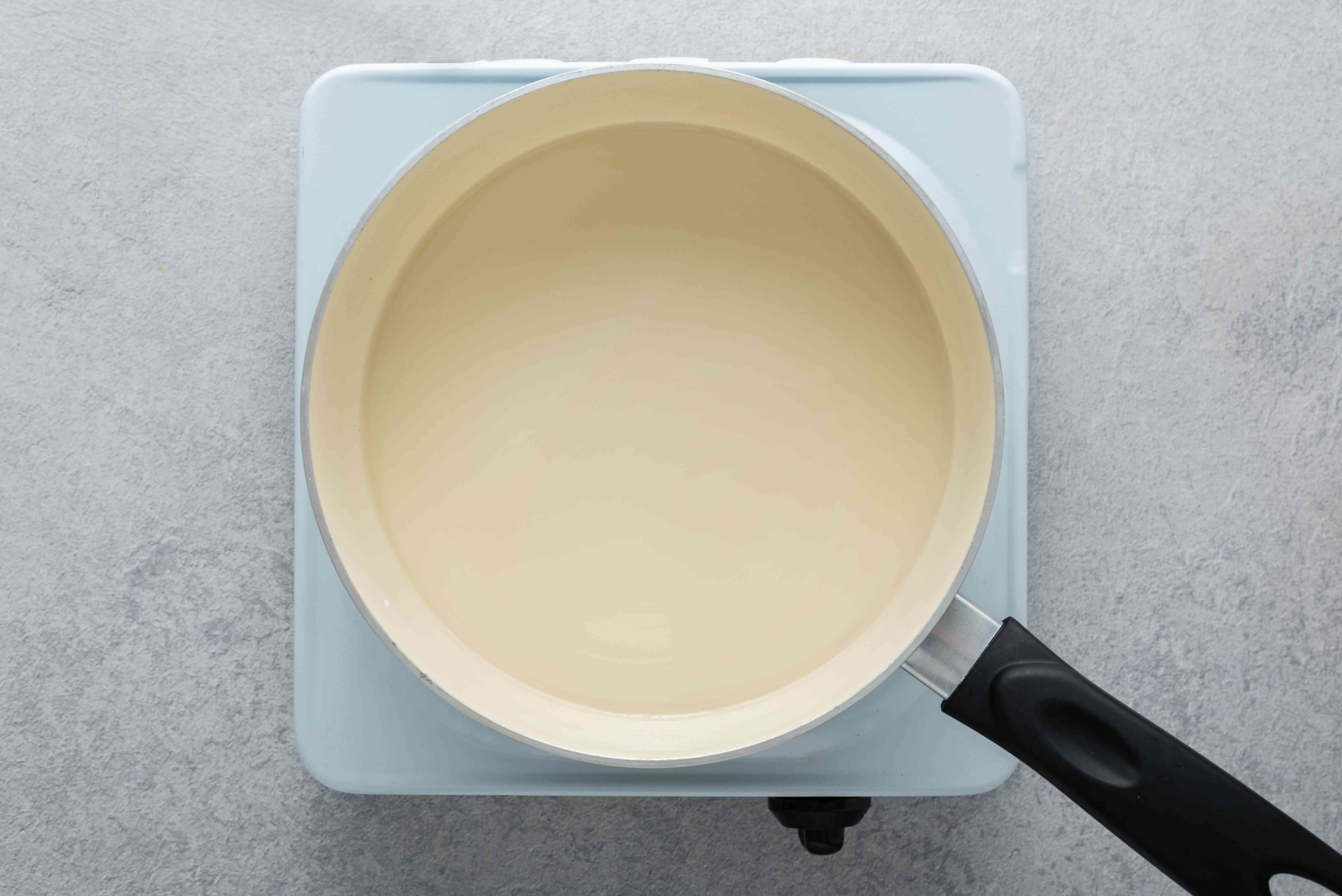 Fish stock and milk in a large saucepan