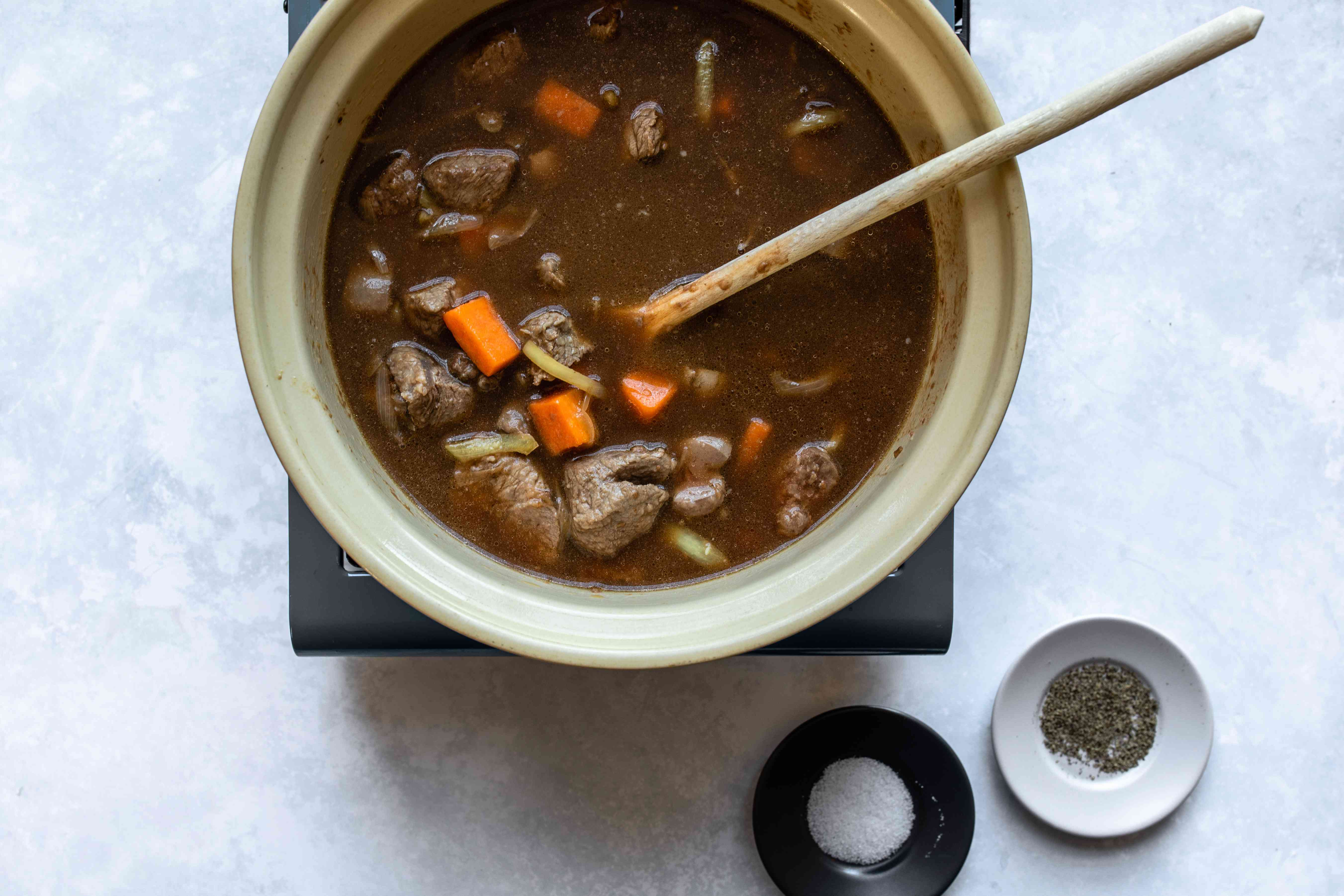 Return meat to pan and add stock