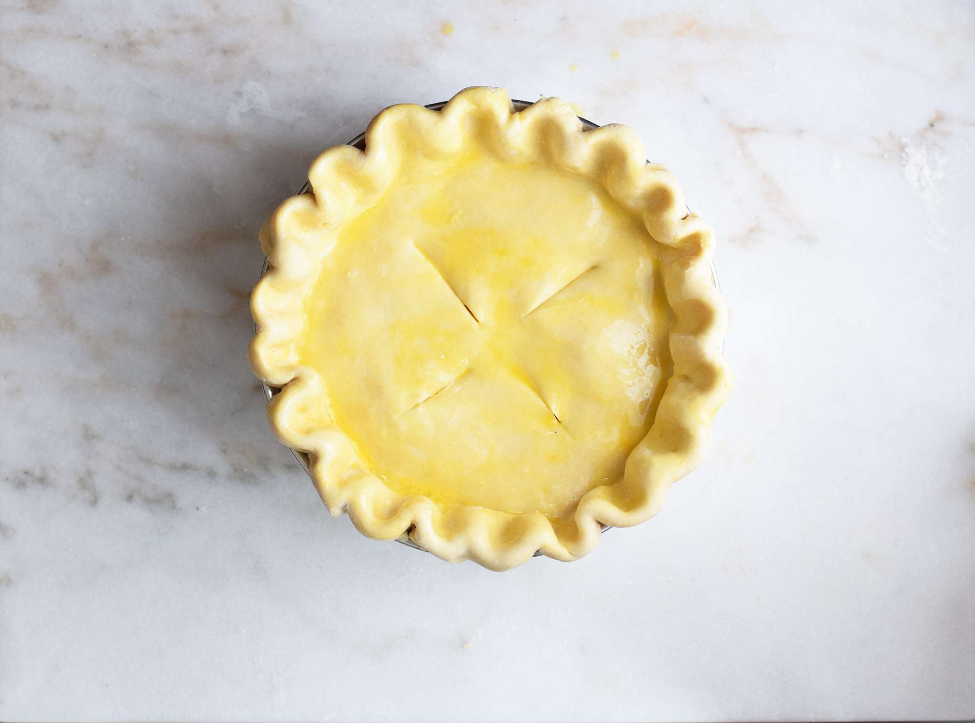 egg wash brushed on top of the Easter pie