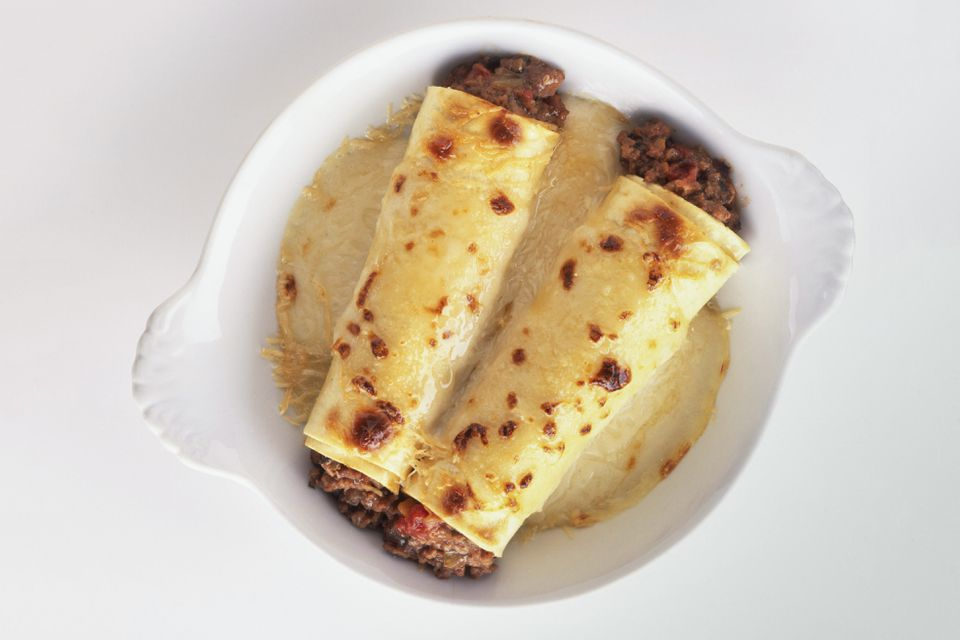 Meat-filled manicotti in white sauce