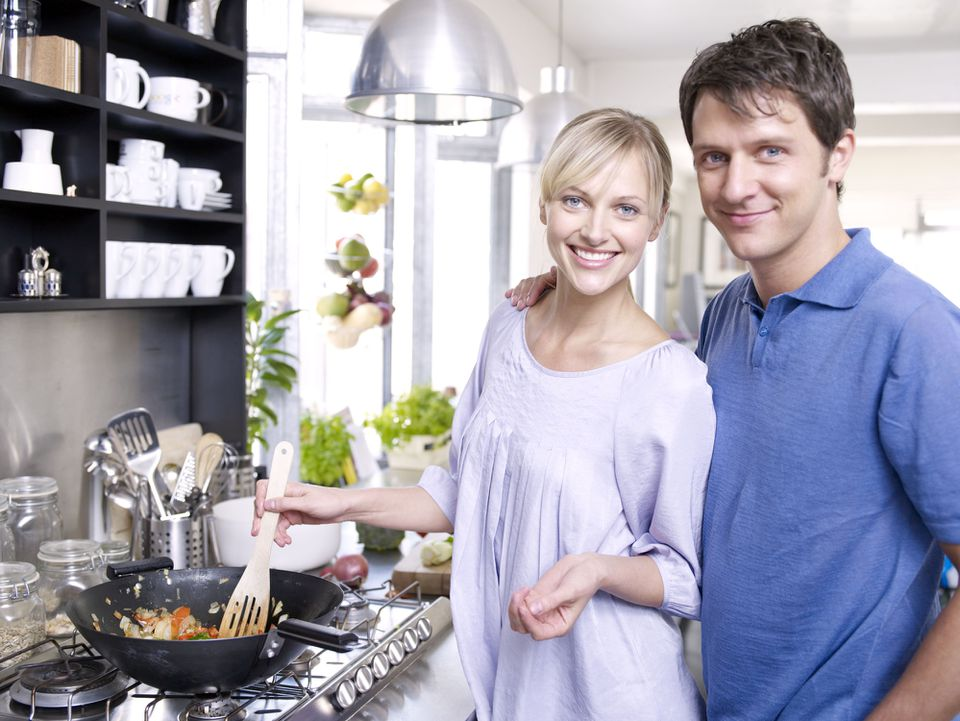 couple cooking with wok