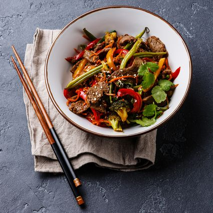 Szechuan beef stir-fried with vegetables in bowl