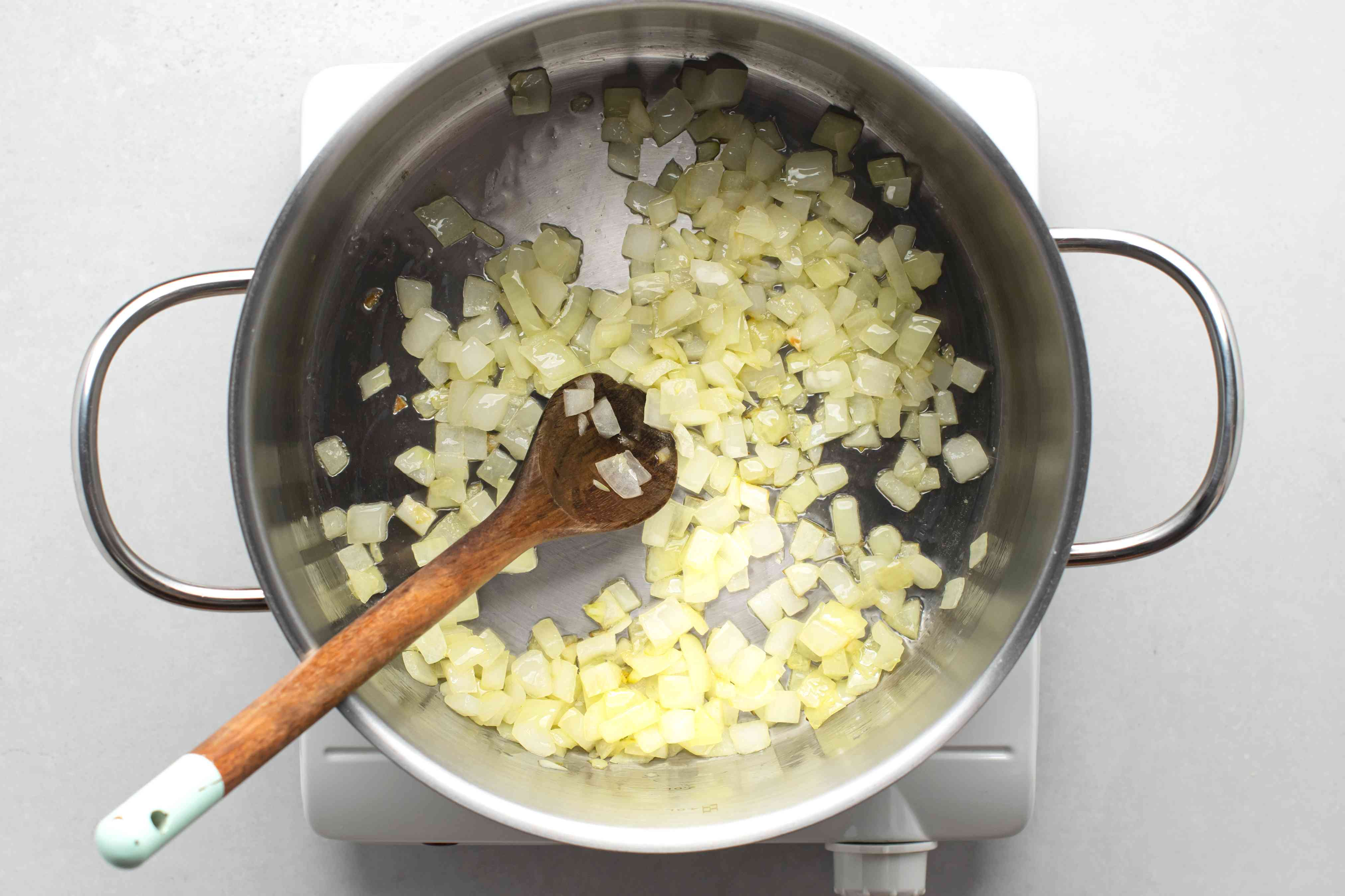 onions and oil cooking in a pot