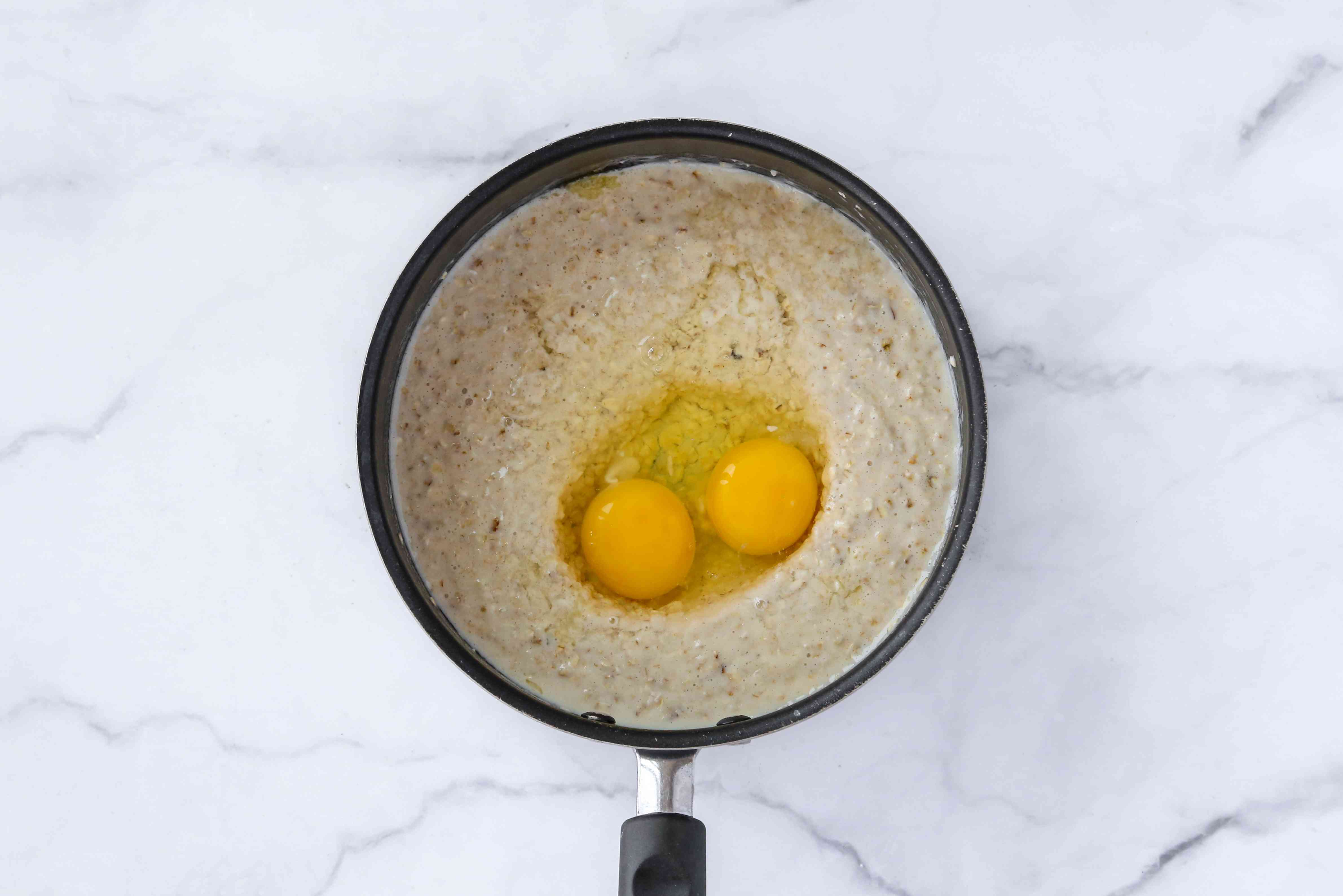 eggs added to the oatmeal mixture in the saucepan