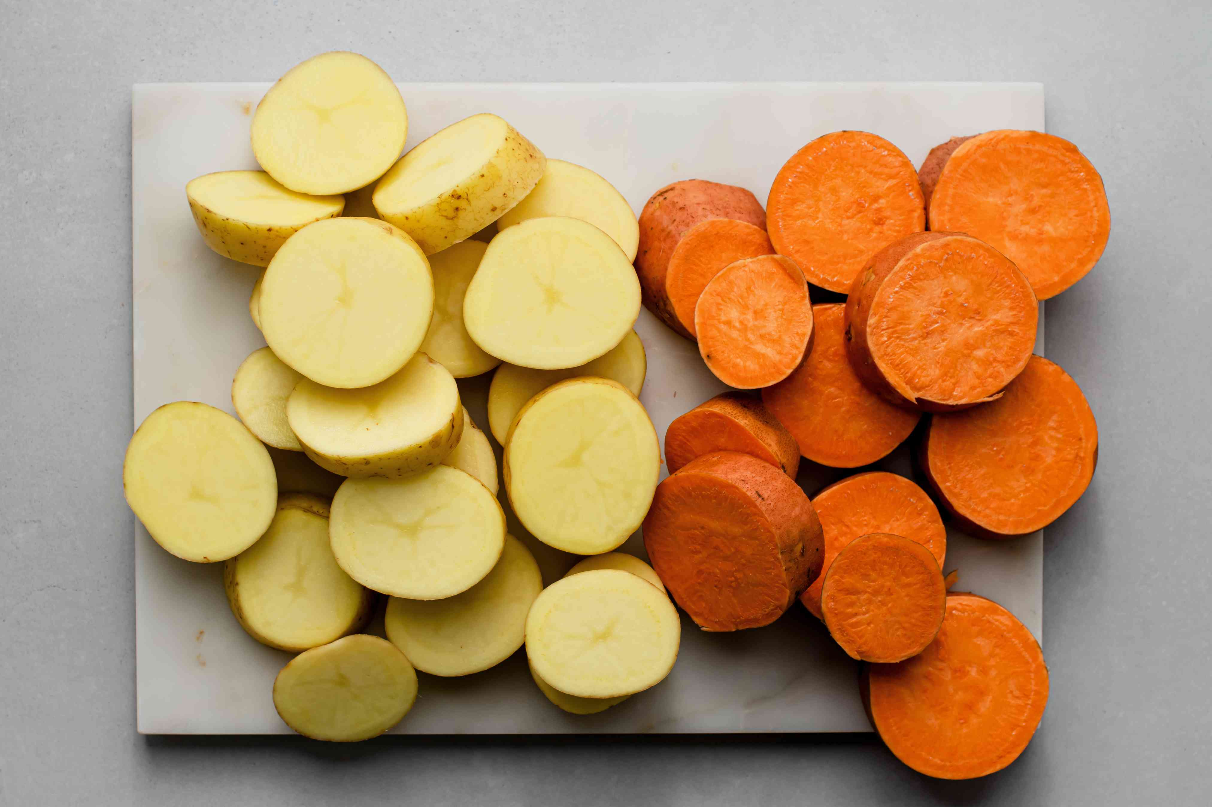 White and sweet potatoes cut into 1-inch-thick slices