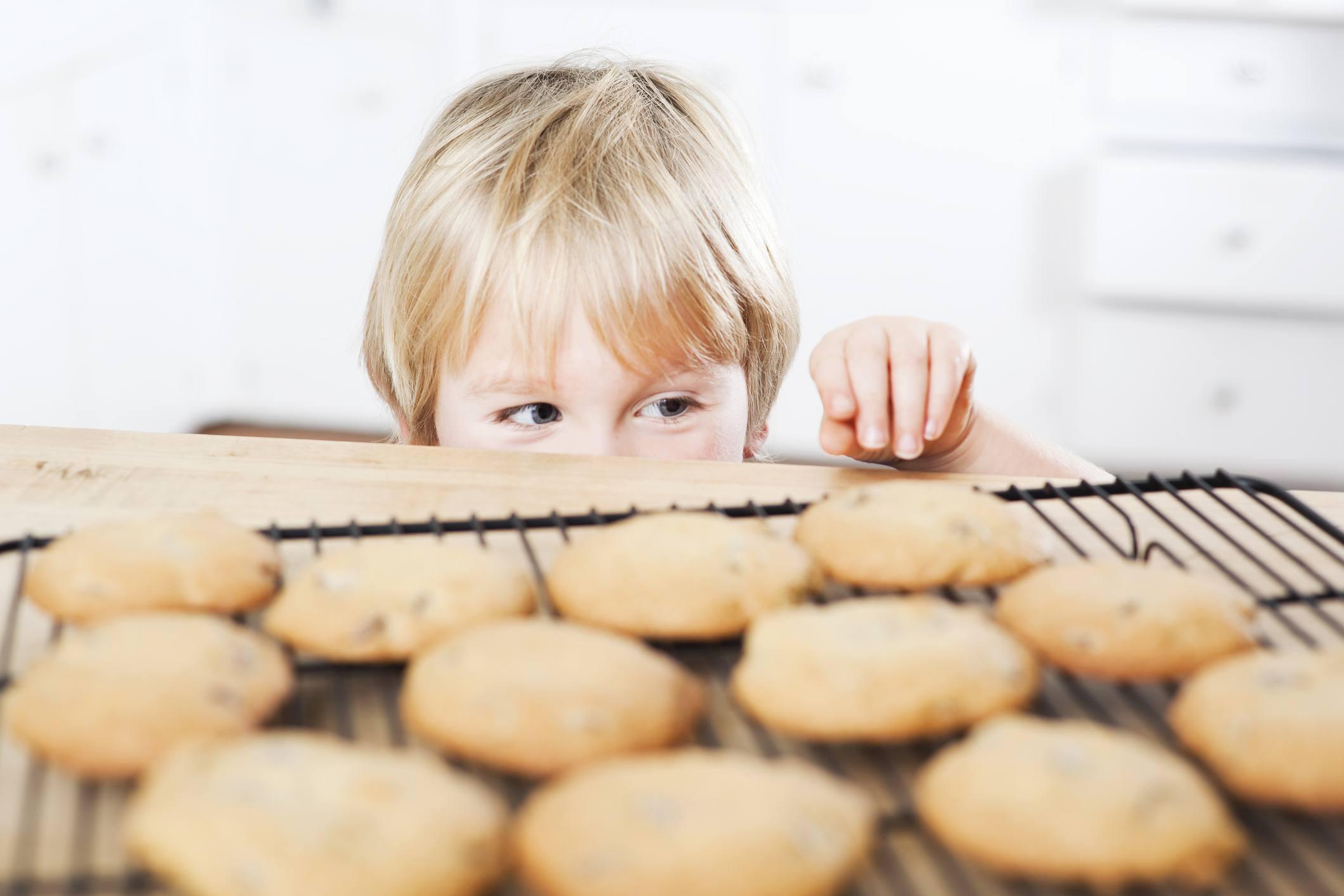 Littel boy sneaking cookies