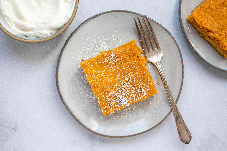 Pumpkin gooey butter cake slice on a plate