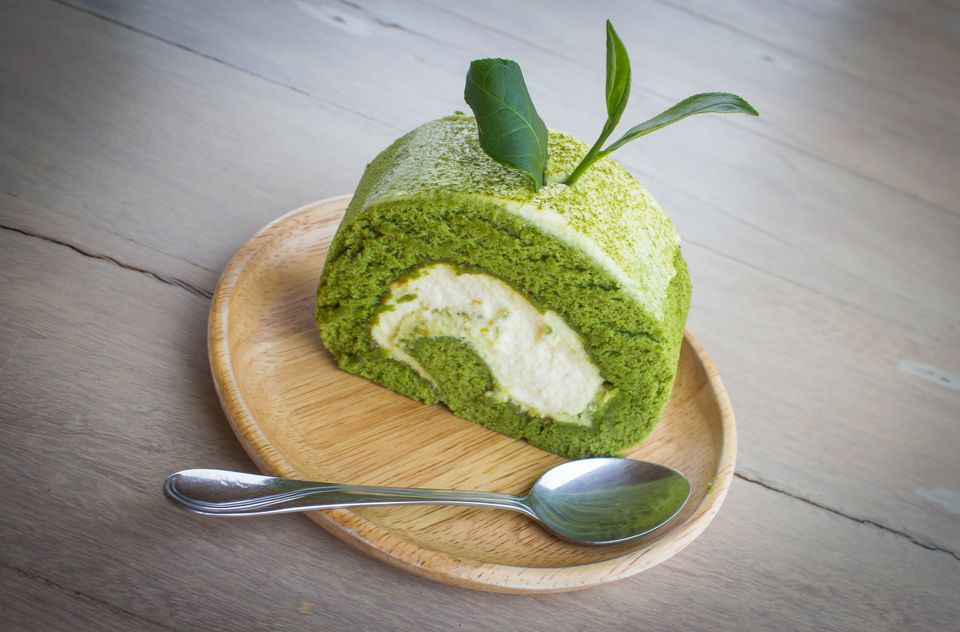 High Angle View Of Matcha Green Tea Cake Served In Plate On Table