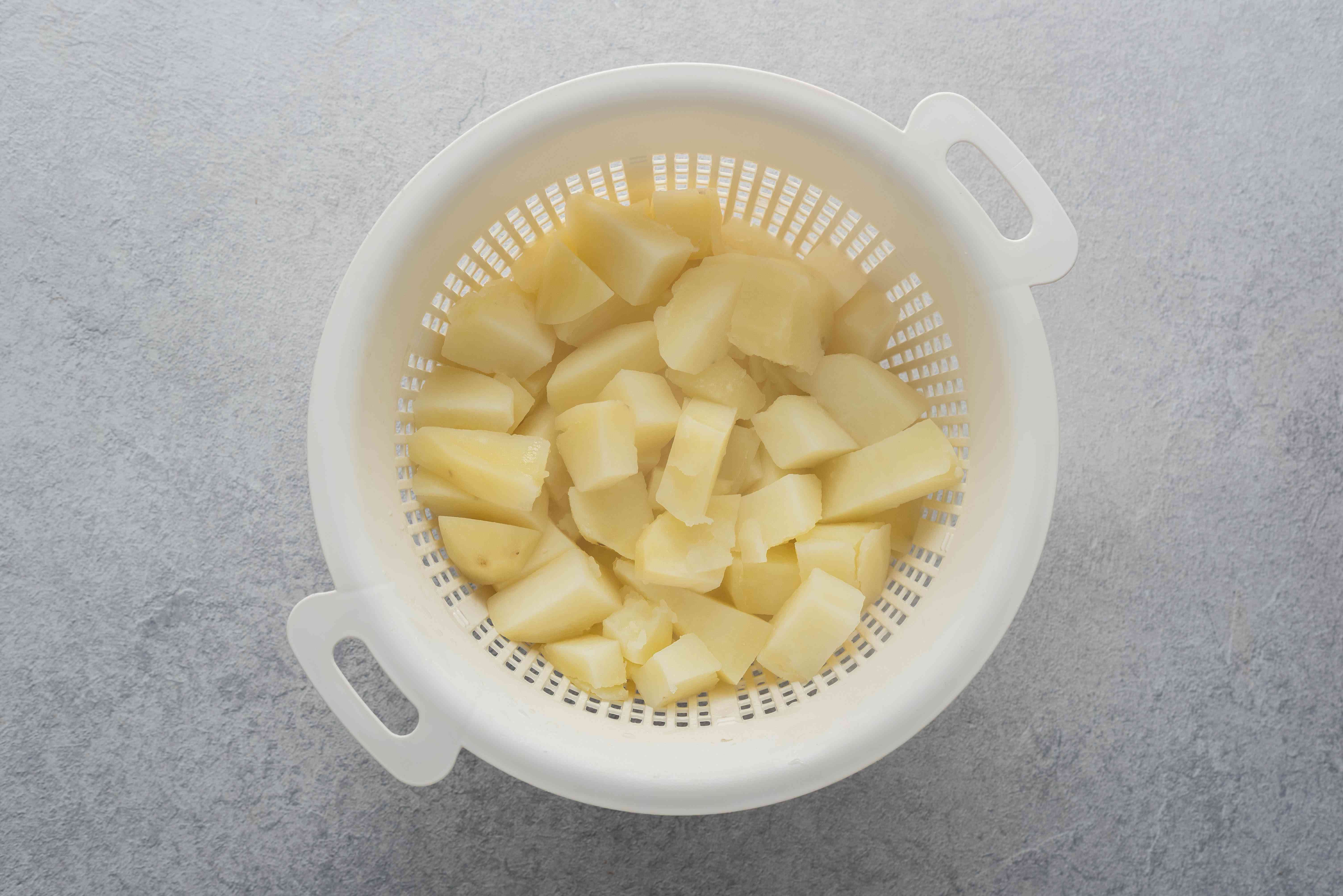 drain the potatoes in a colander