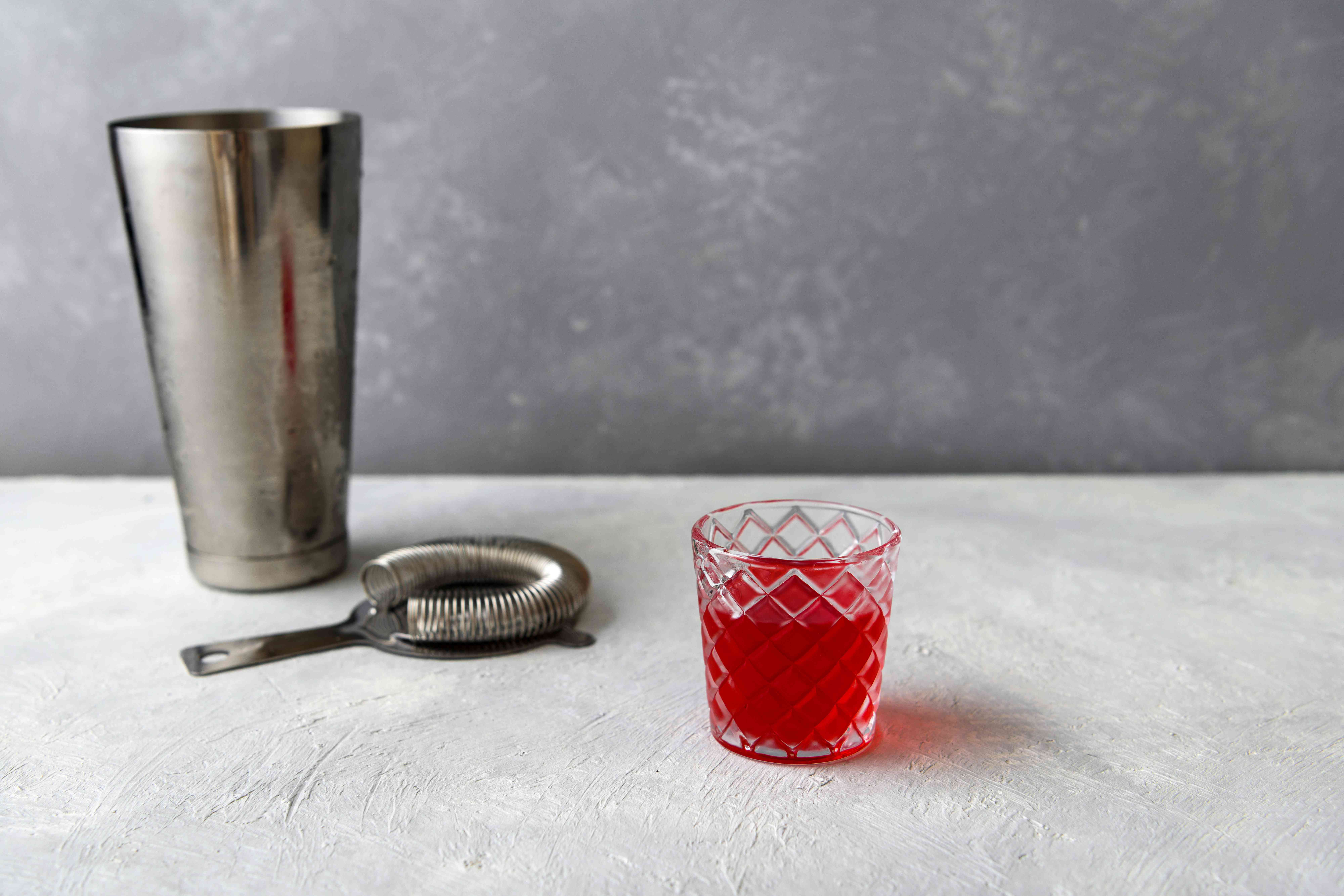 strain cocktail into the glass