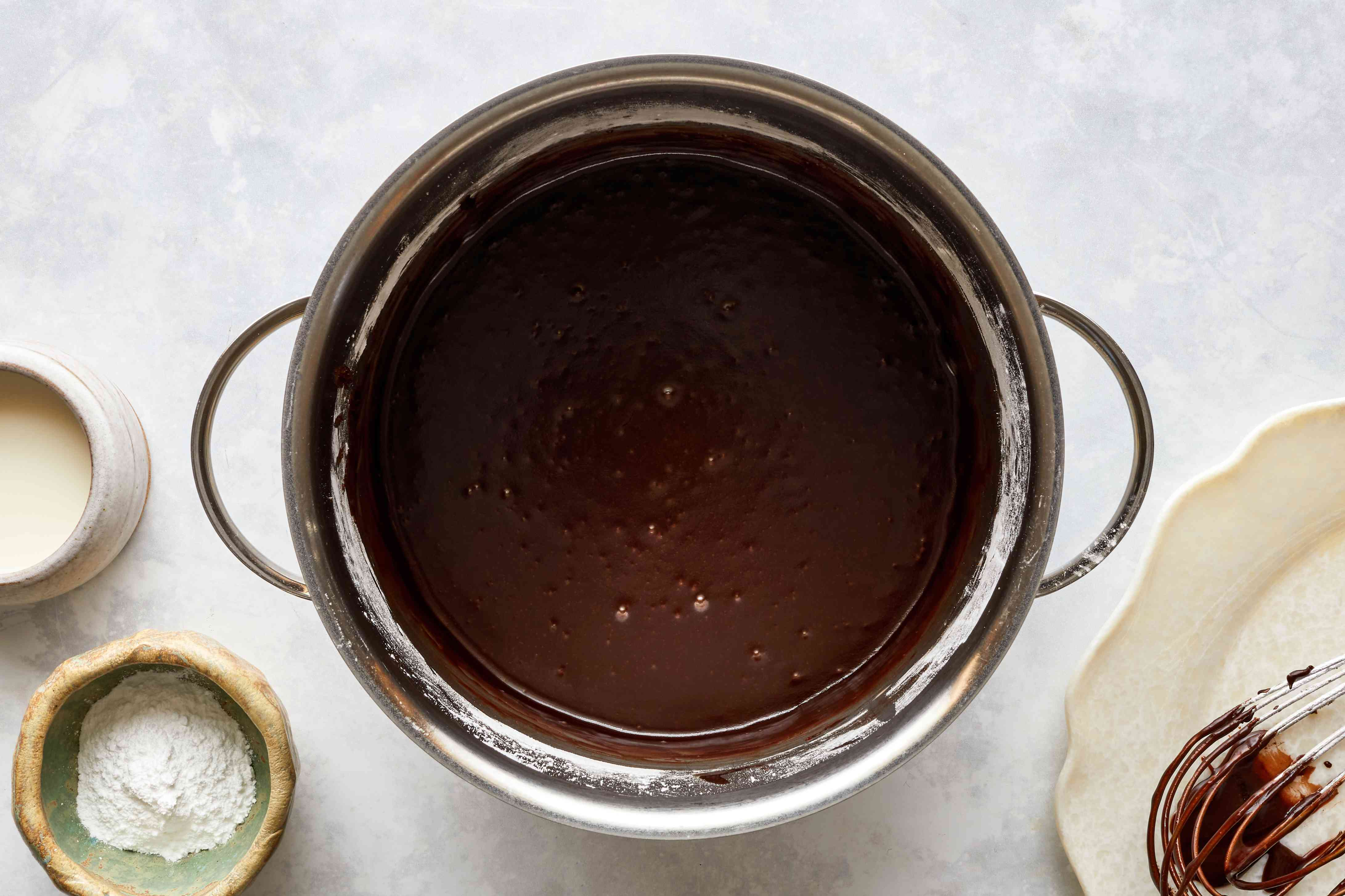 chocolate glaze in a bowl, mixture of butter, milk, cocoa powder, and confectioners' sugar