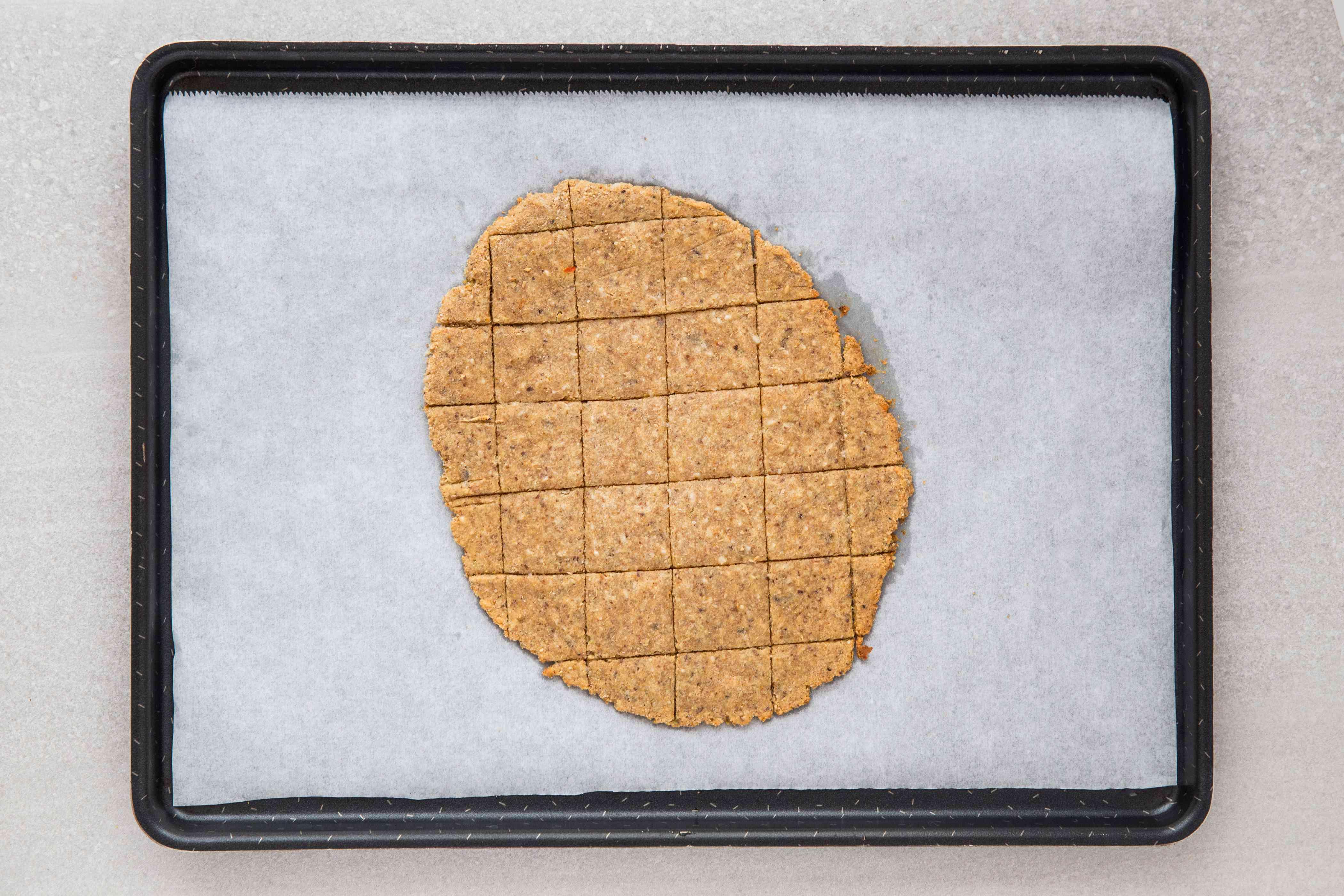 flax cracker dough on a baking sheet